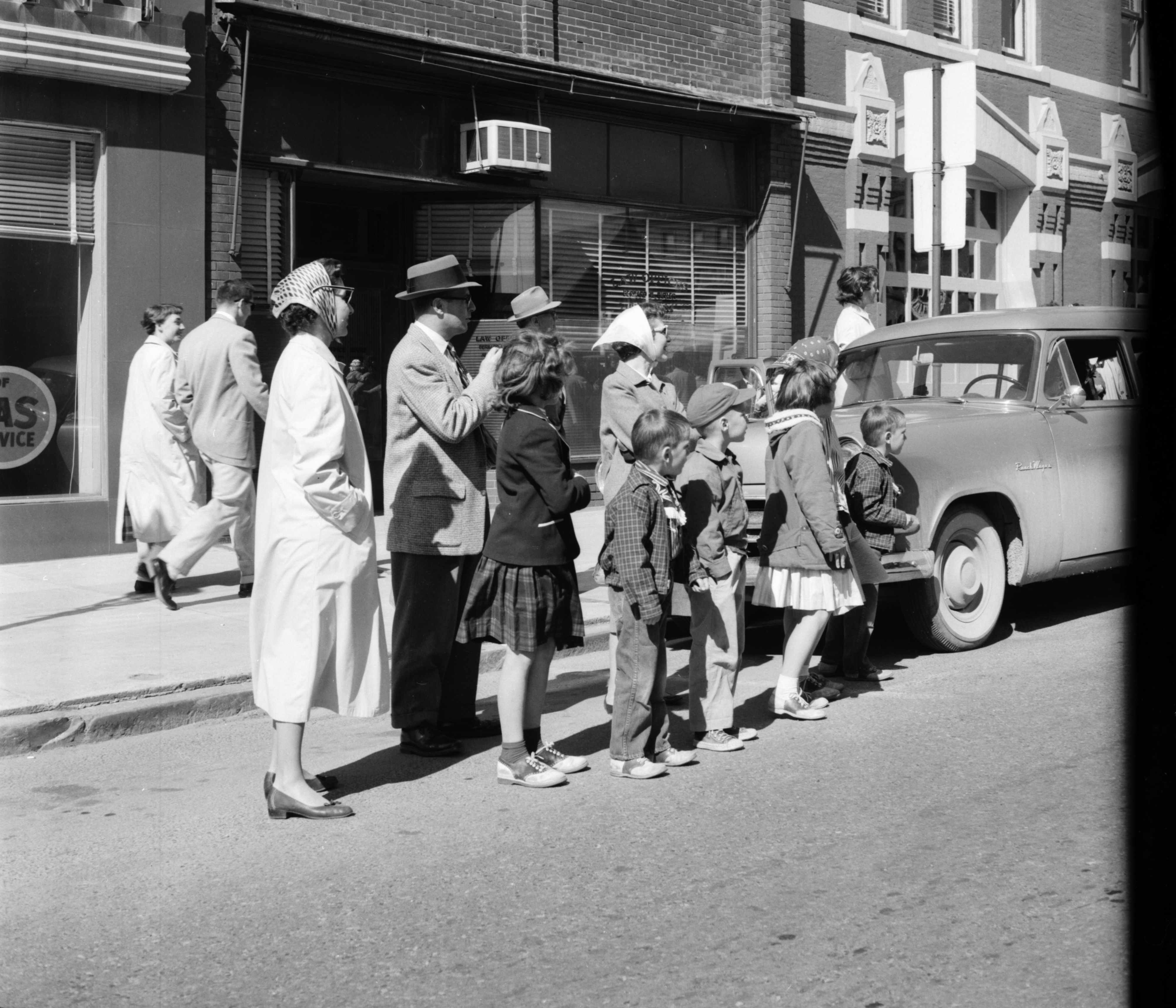 Watching the Michigras Parade, April 1958 image