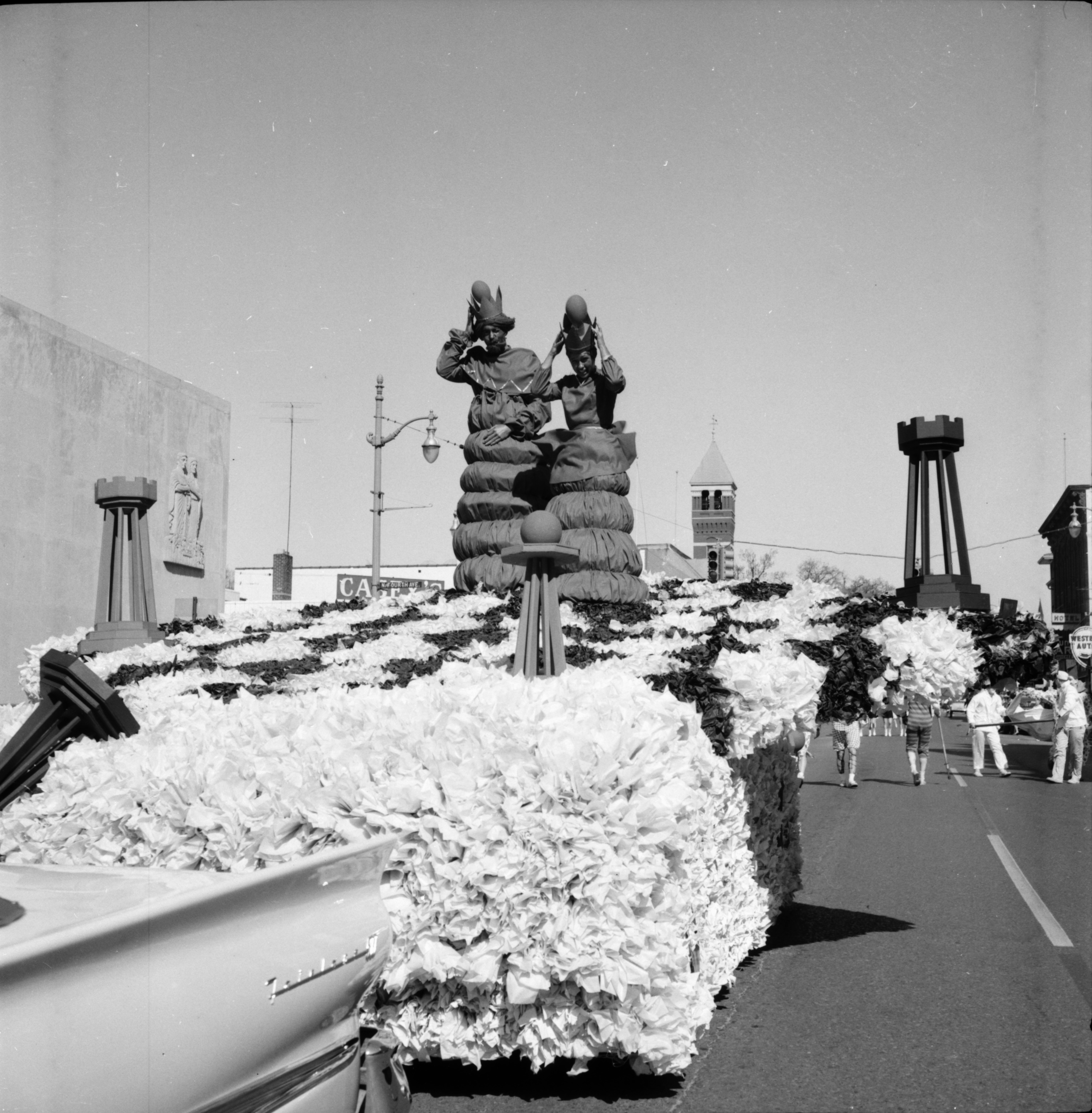 Floats Pass by the Washtenaw County Building during the Michigras Parade, April 1958 image