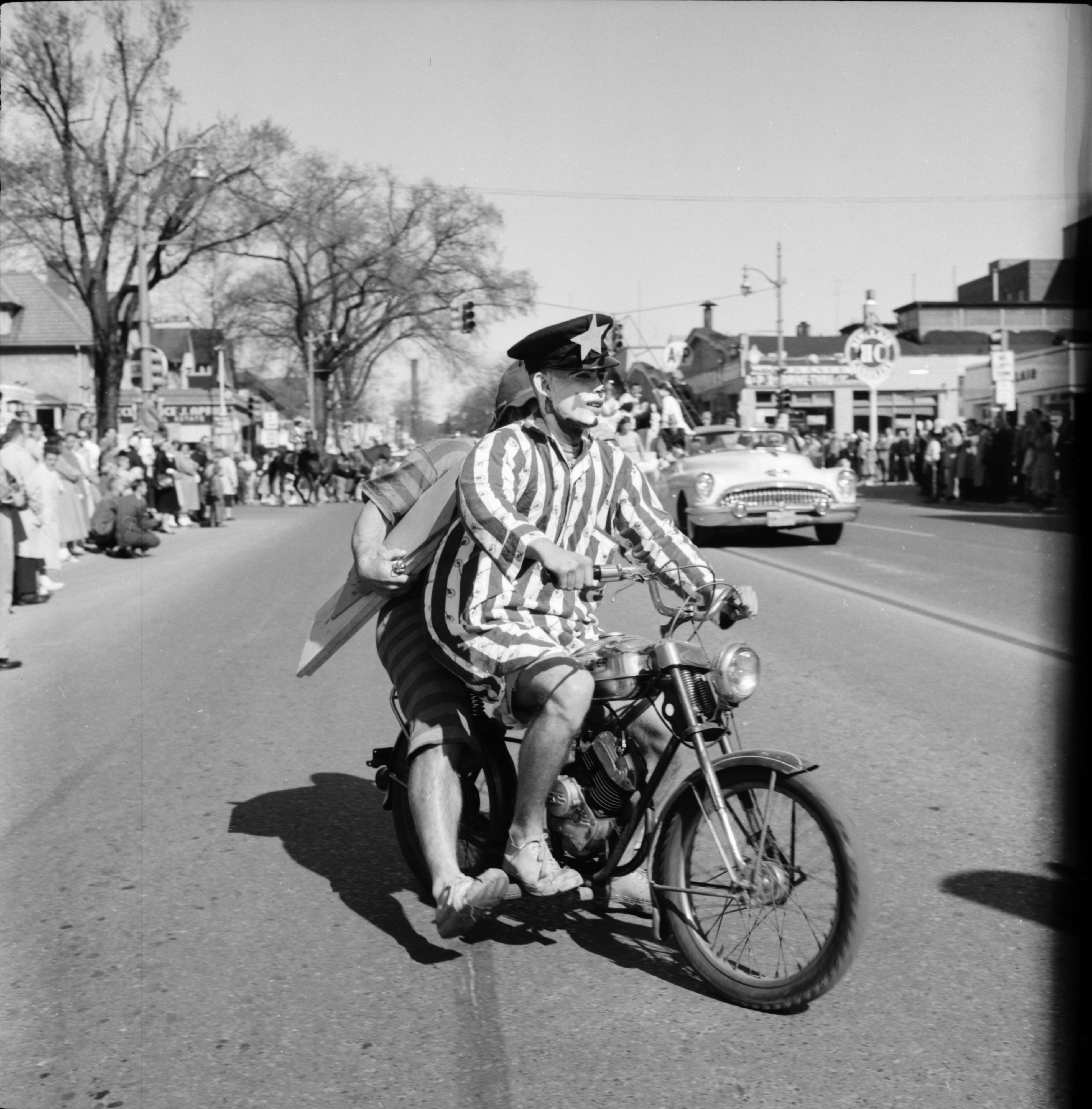 Clowning around in the Michigras Parade, April 1958 image
