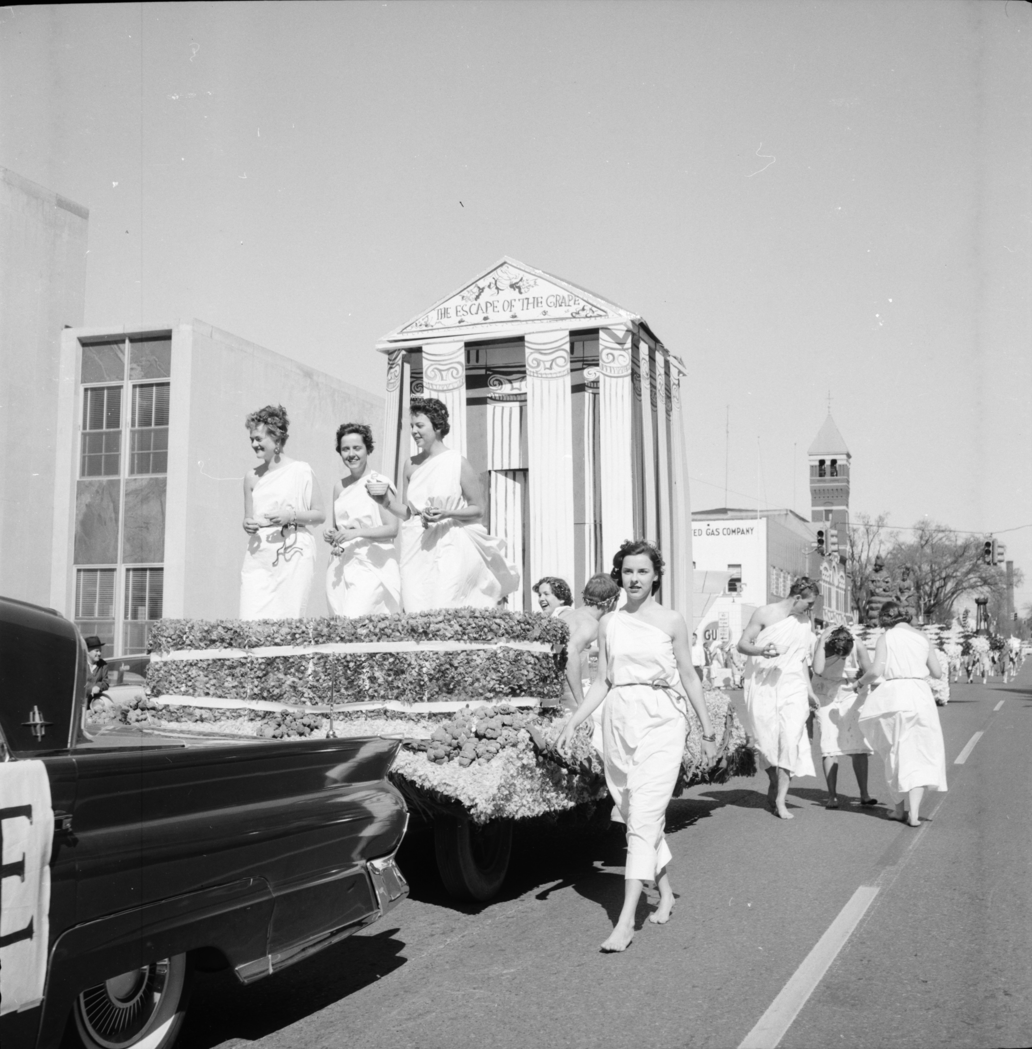 A Float Passes By the Washtenaw County Building in the Michigras Parade, April 1958 image