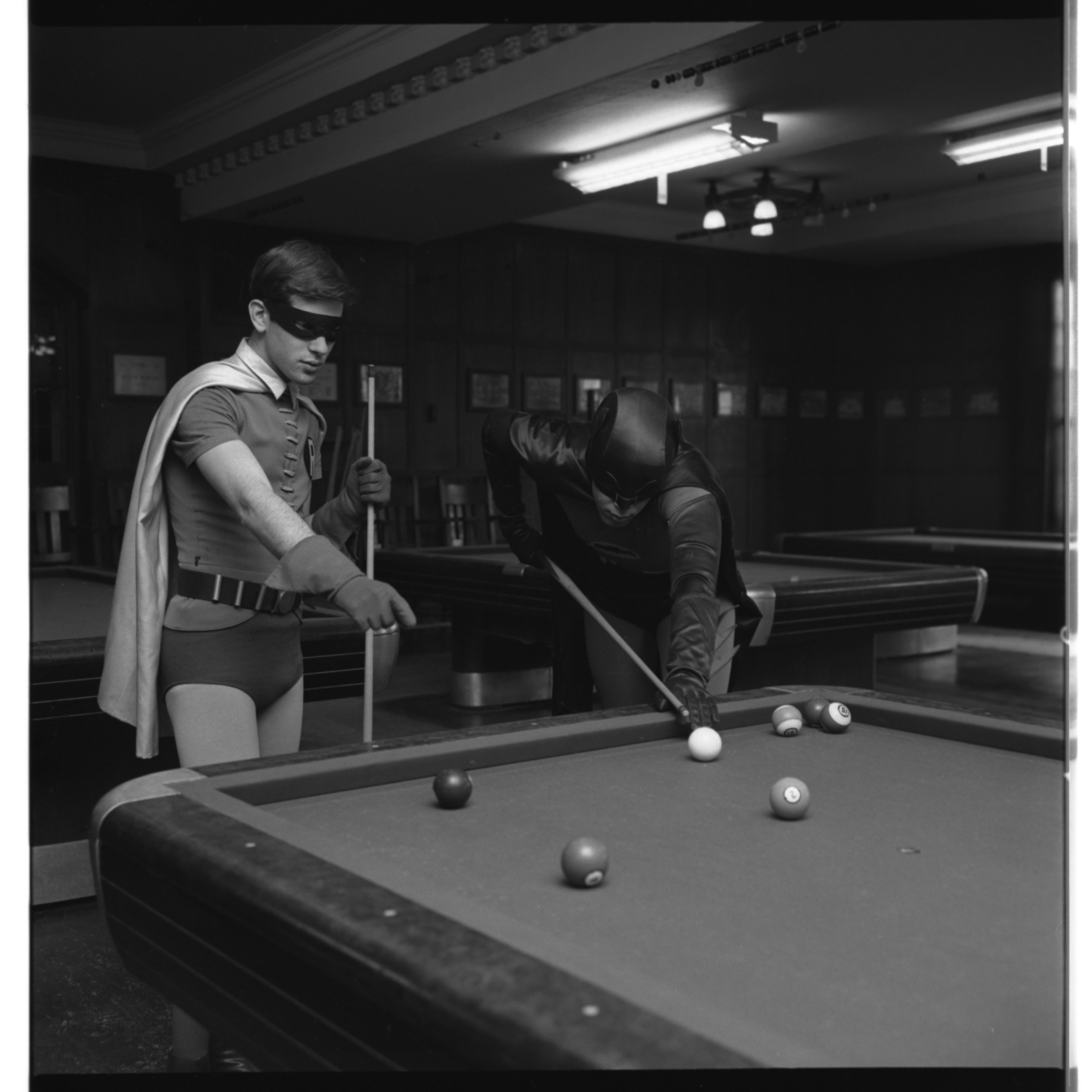 Batman And Robin Play Pool At The Michigan Union