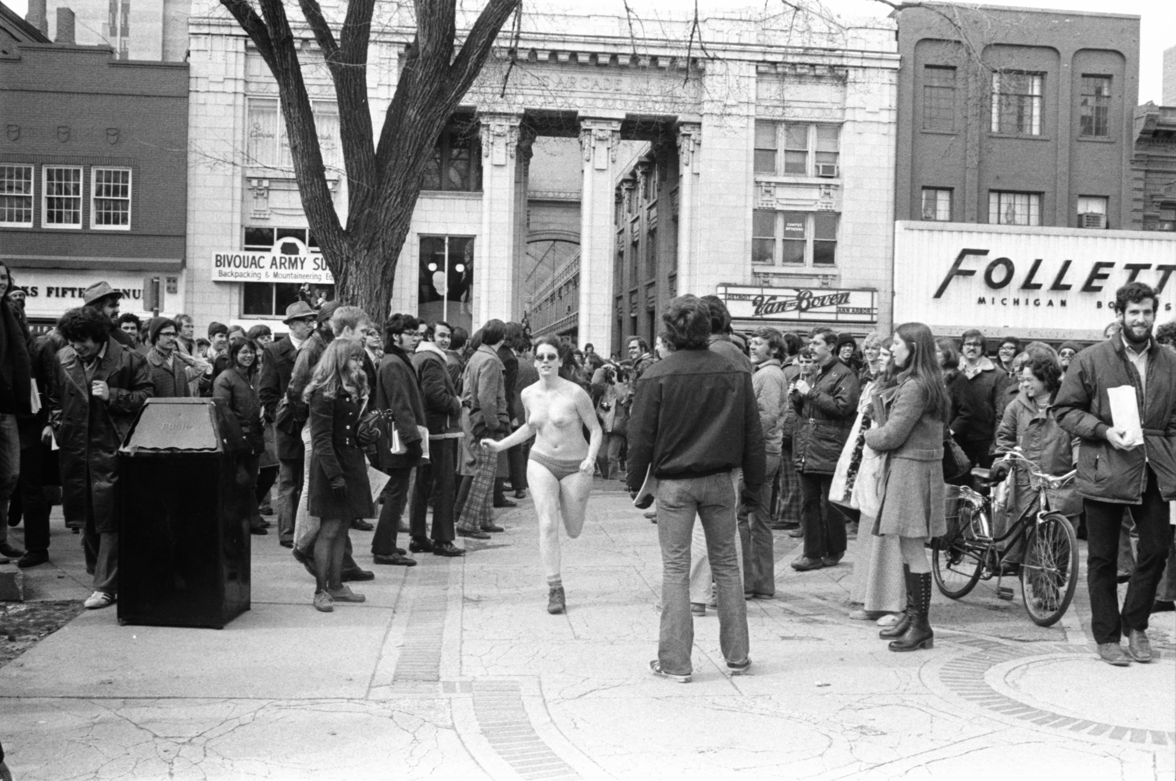A streaker runs on campus near Nickels Arcade, March 1974 image
