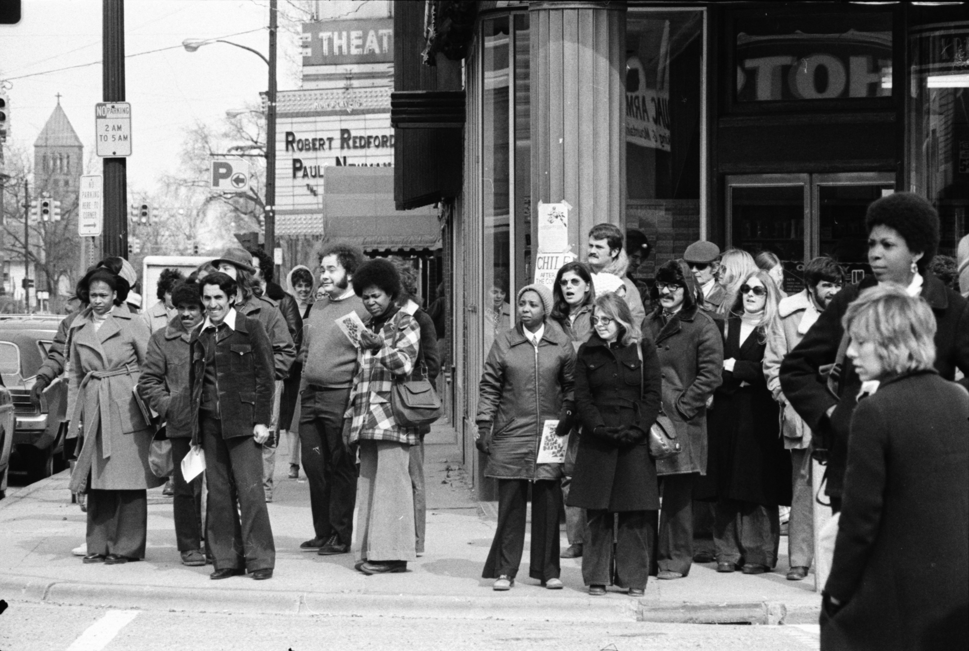 Passersby on the corner of North University Avenue and State Street watch streakers on U-M campus, March 1974 image