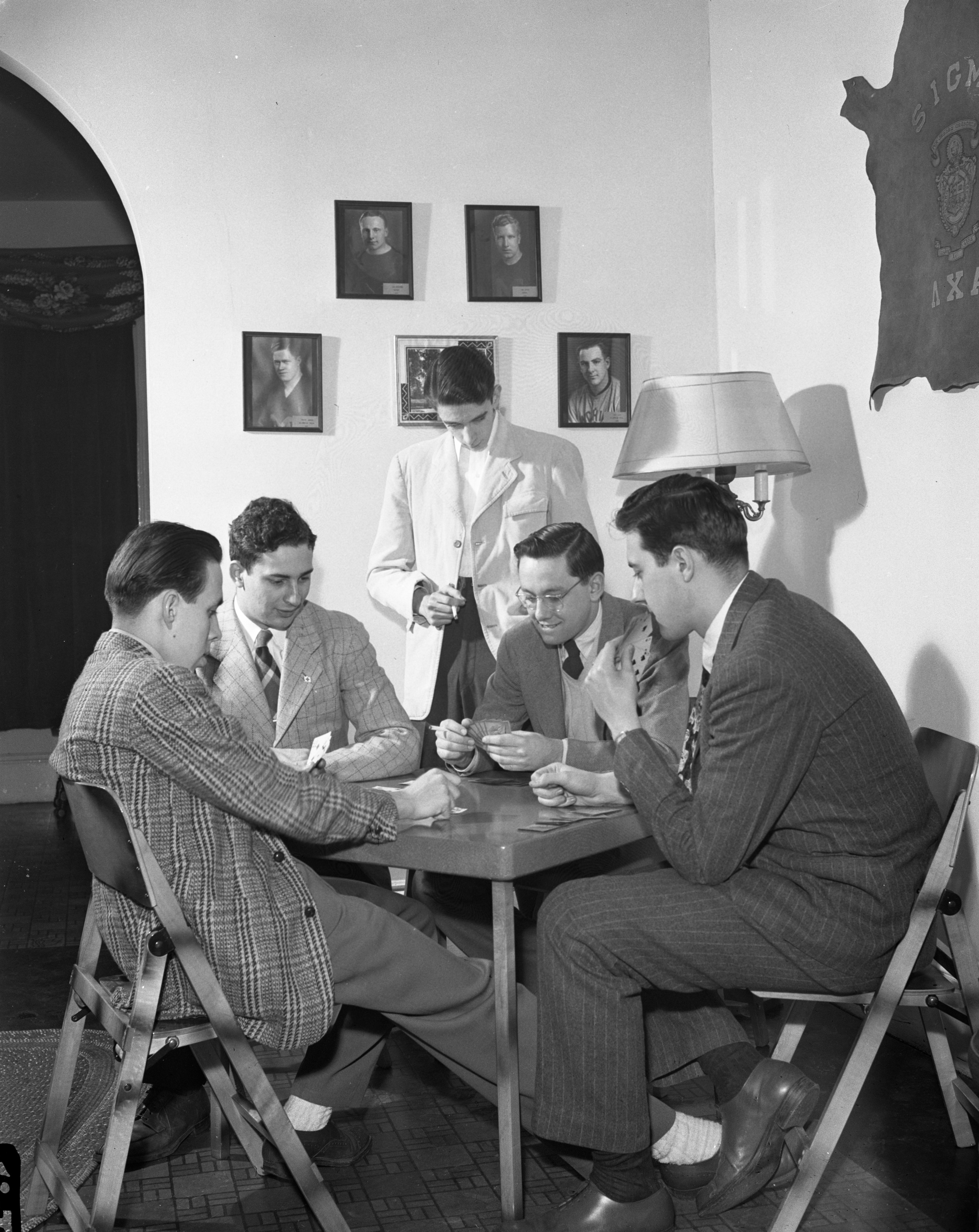 "University Of Michigan Lambda Chi Alpha Fraternity Members Play Cards In Their ""Duration"" Wartime Apartment, March 1944 image"