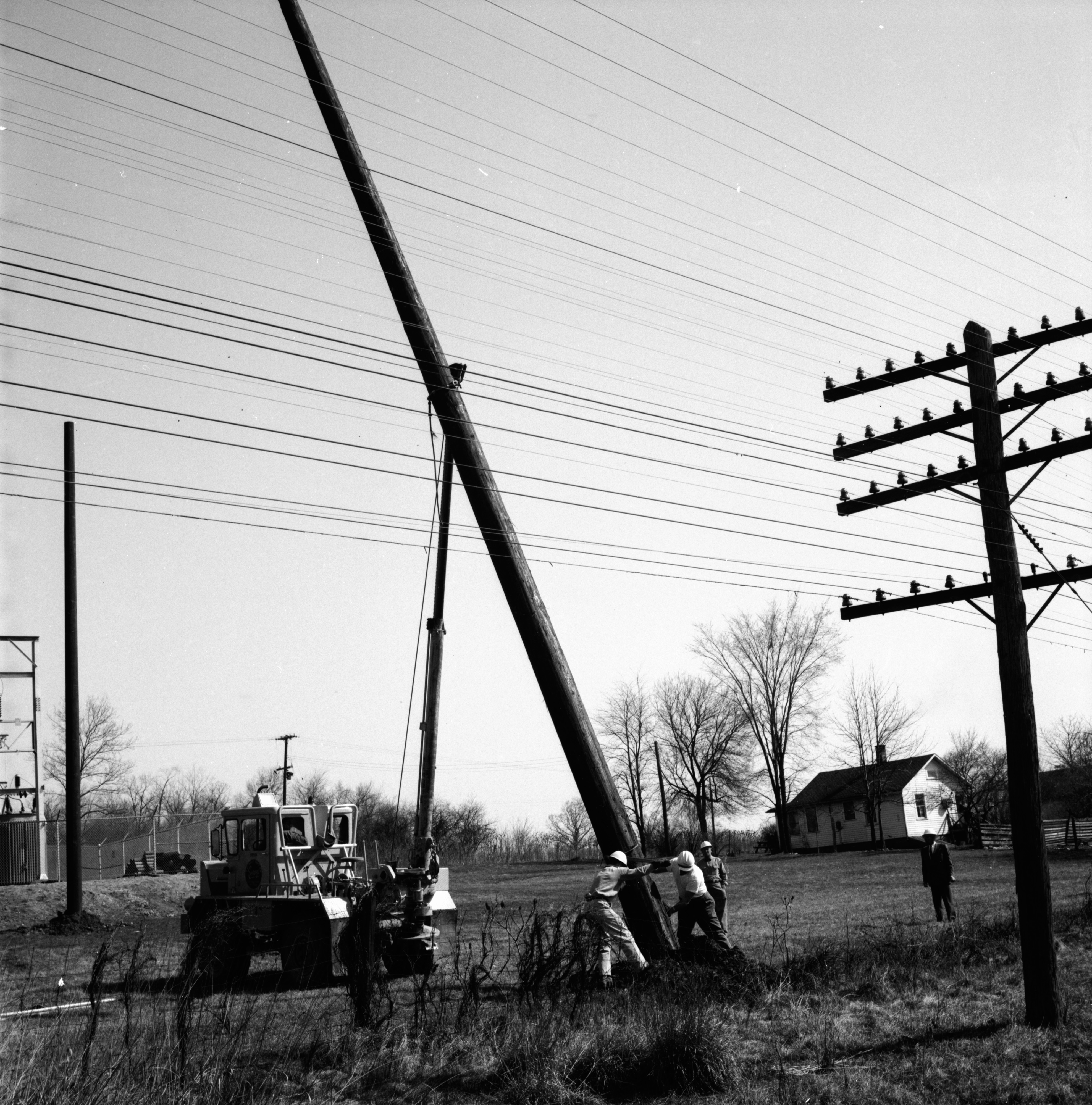 Detroit Edison Workers Putting up Electric Pole | Ann Arbor