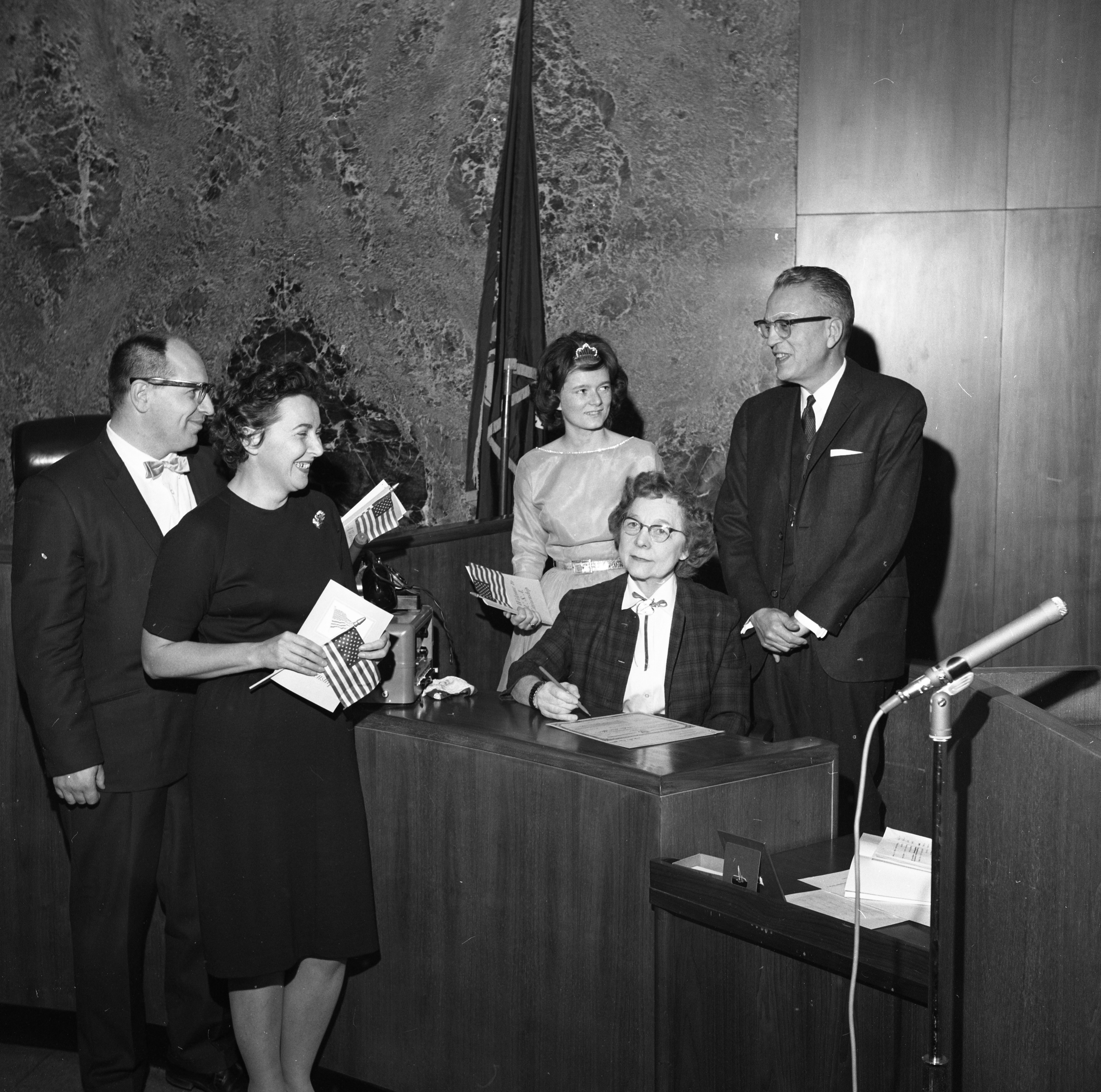 County Clerk Luella M. Smith Completes Citizenship Papers for New Citizens, November 1962 image