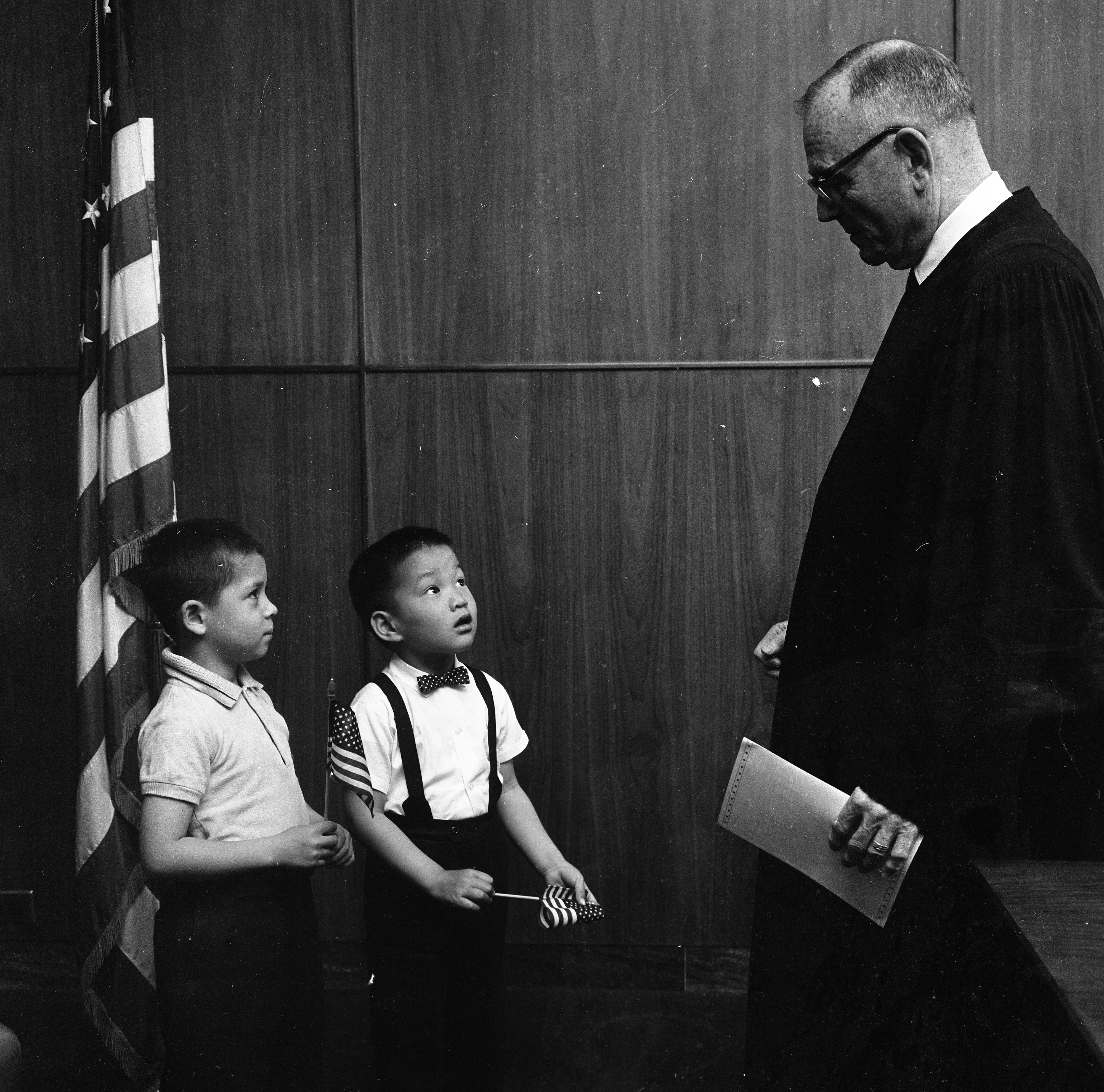 Judge James R. Breakey Jr. Congratulates Two New U.S. Citizens, May 1963 image