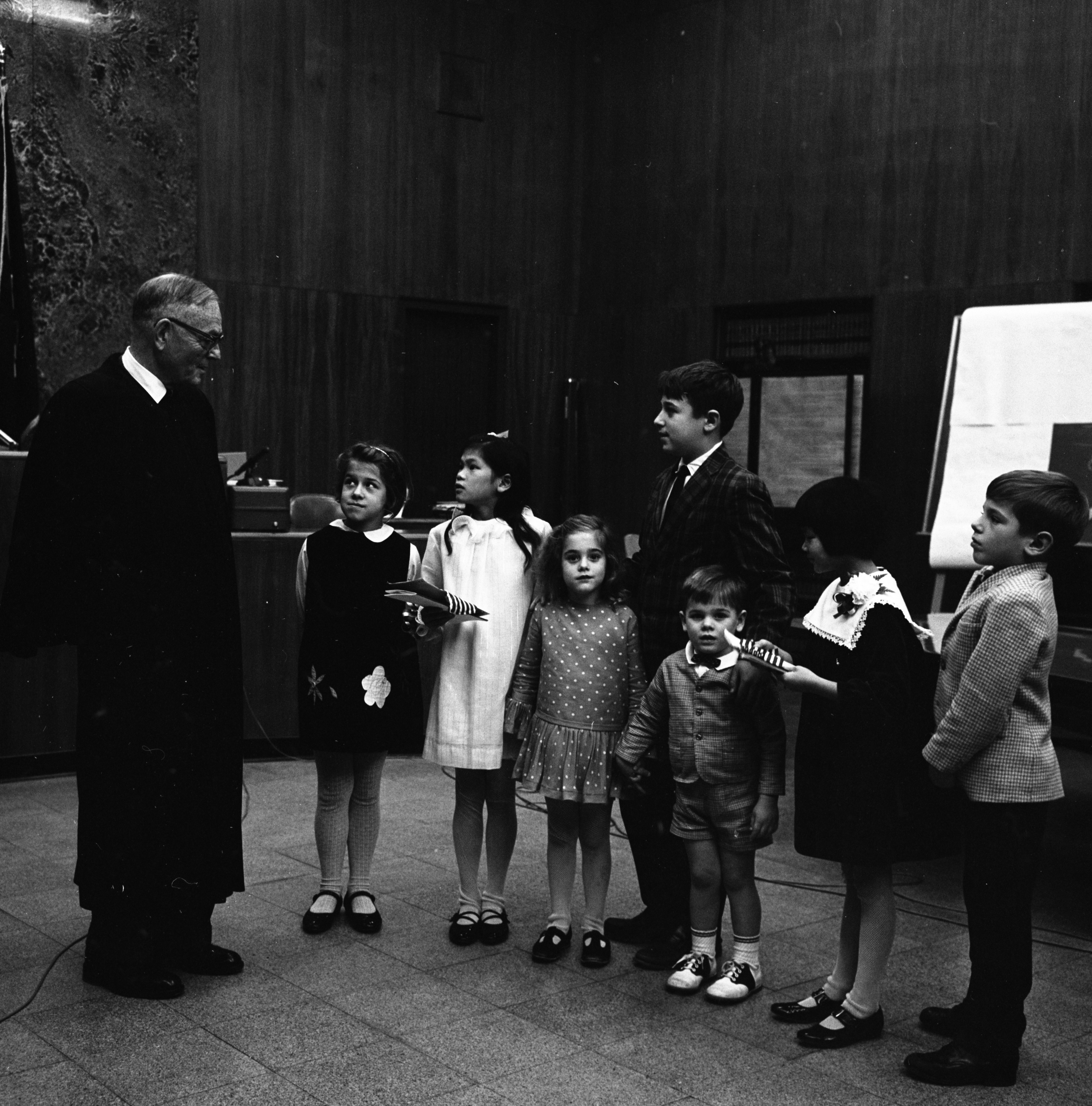 Judge James R. Breakey Jr. Congratulates New U. S. Citizens Cecilia Oi-Chan Hooper and Jeanne D'Arc Hooper, November 1967 image