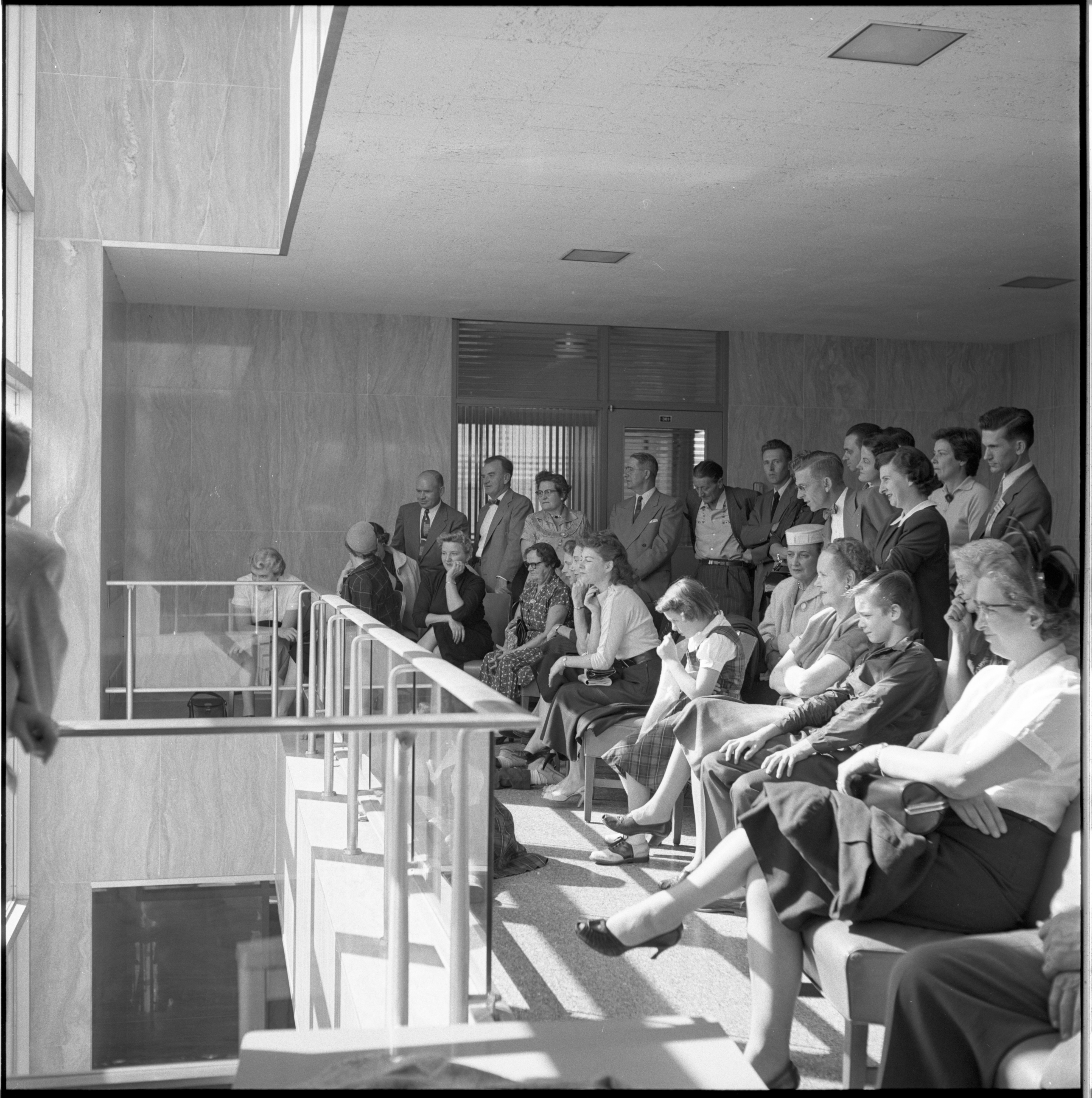 Spectators Watch The Washtenaw County Building Dedication Ceremony From Inside The Building, October 1956 image
