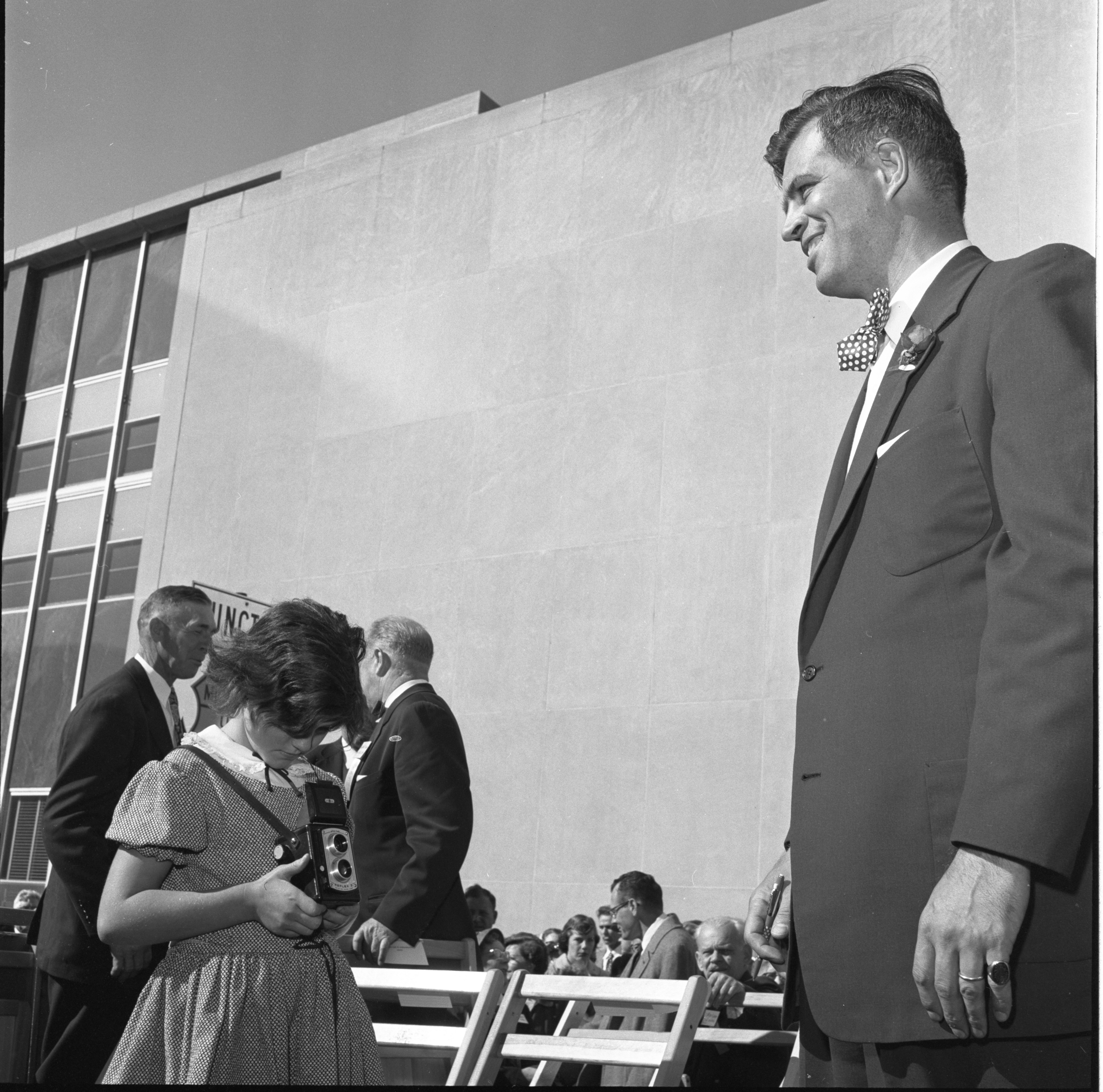 A Child Snaps A Photo Of Gov. G. Mennen Williams At The Washtenaw County Building Dedication Ceremony, October 1956 image