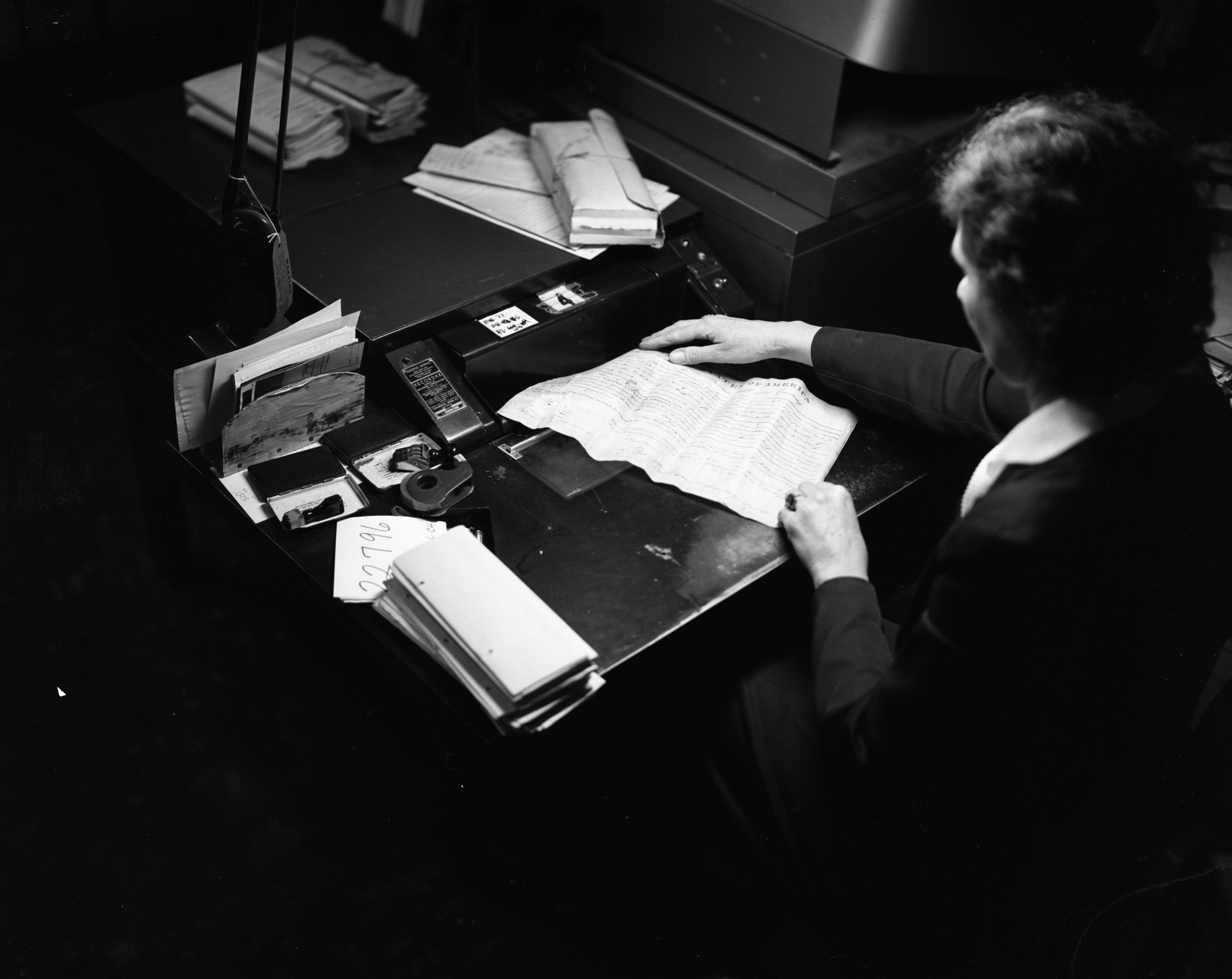 Helen A. Rice microfilms old documents on sheepskin discovered at the Courthouse, February 1955 image