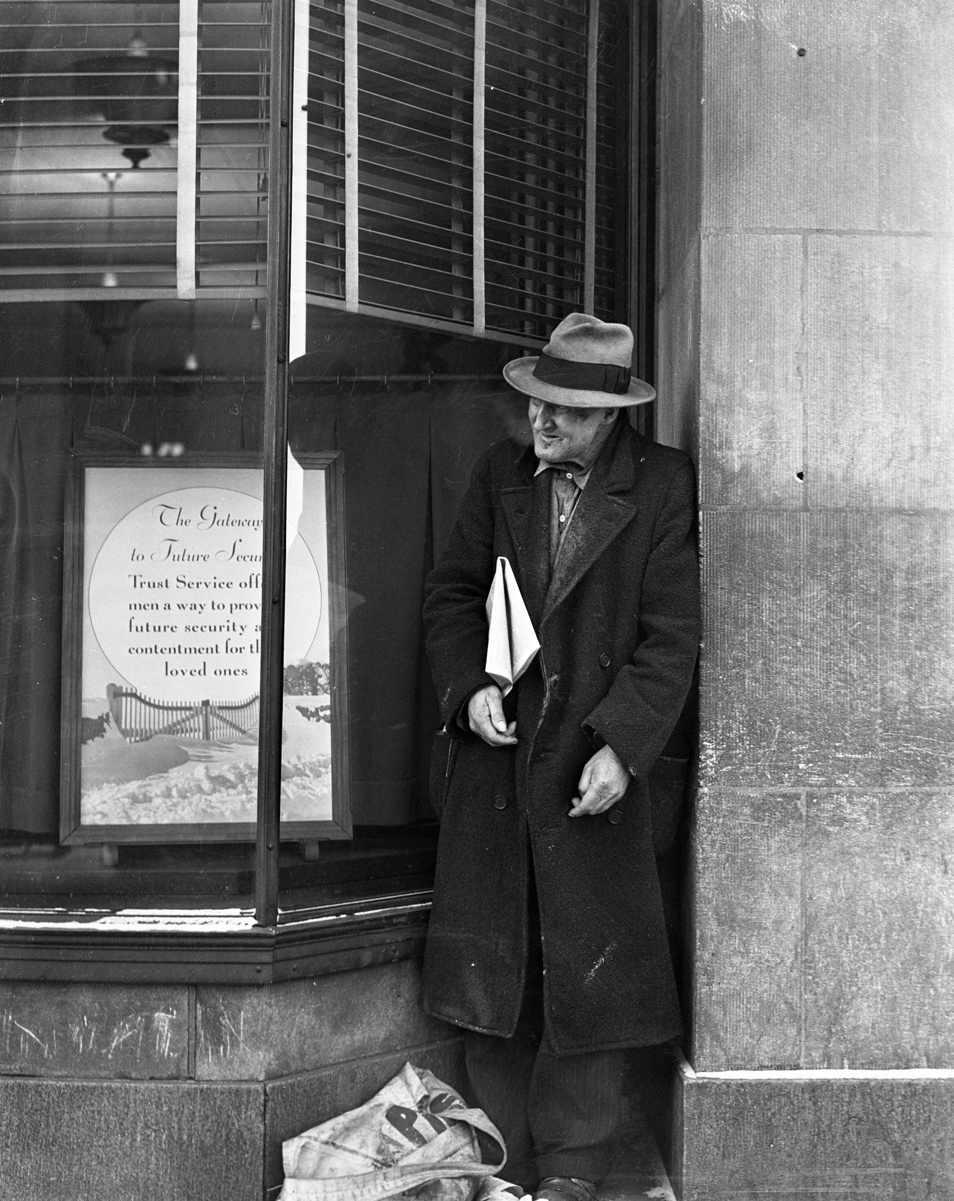 Newsman in front of Ann Arbor Trust, 1938 image