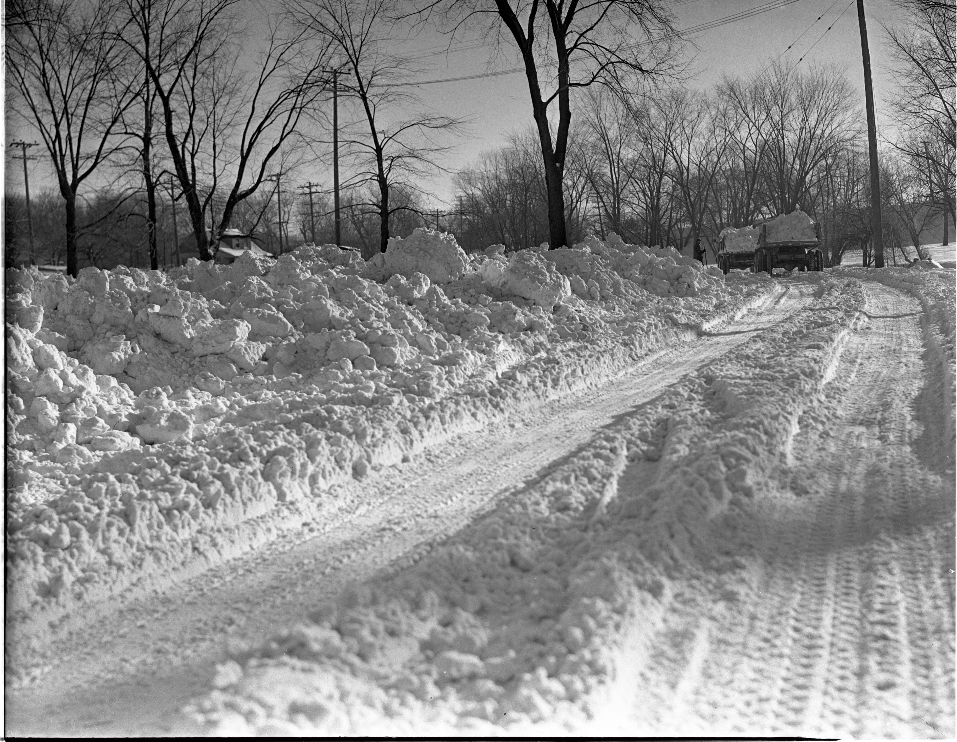 Snow Removal Trucks Haul Snow From Ann Arbor Roads To Huron River, January 1939 image