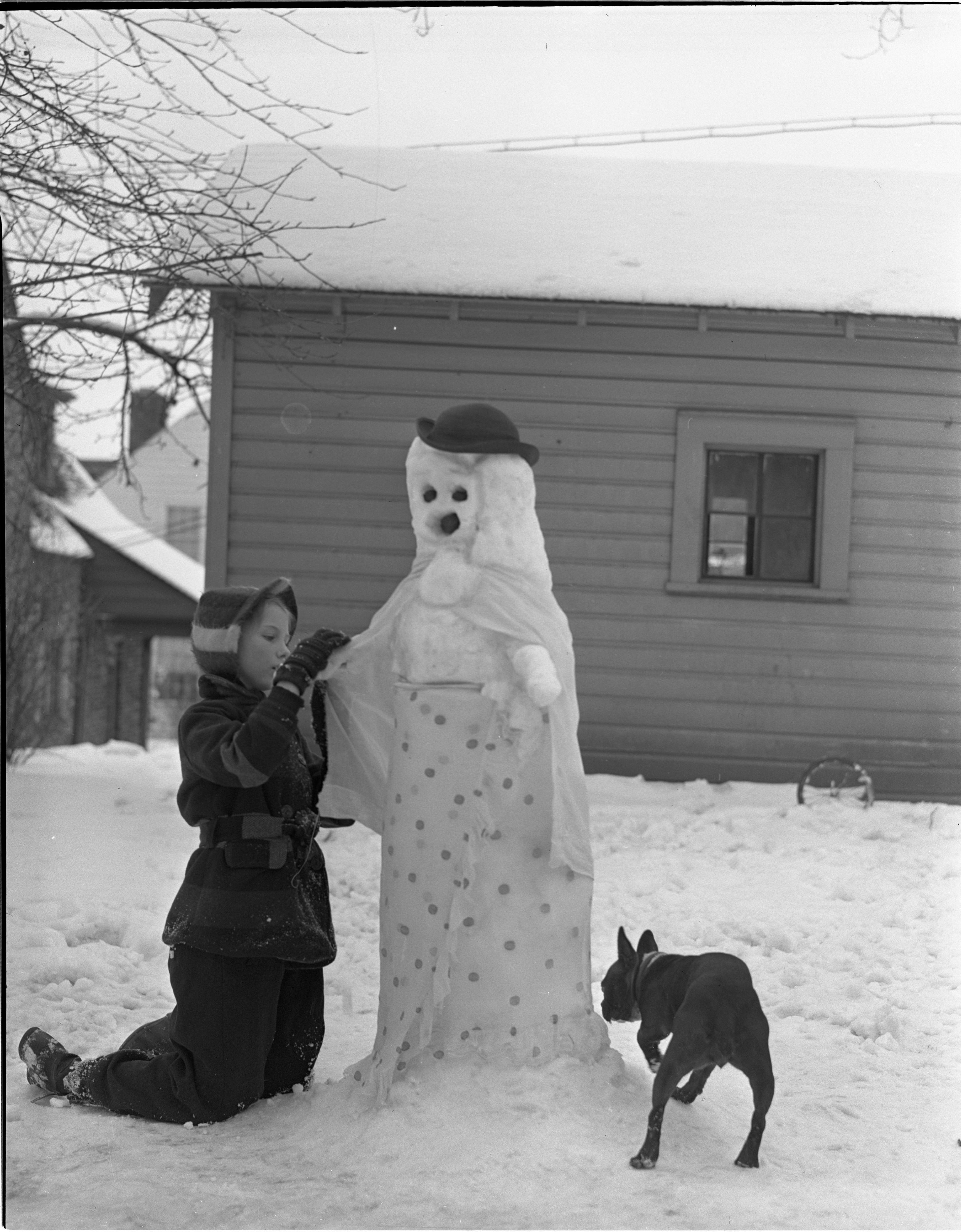 Dorothy Jean Thomas Builds A Snow Lady In Her Yard, February 1940 image