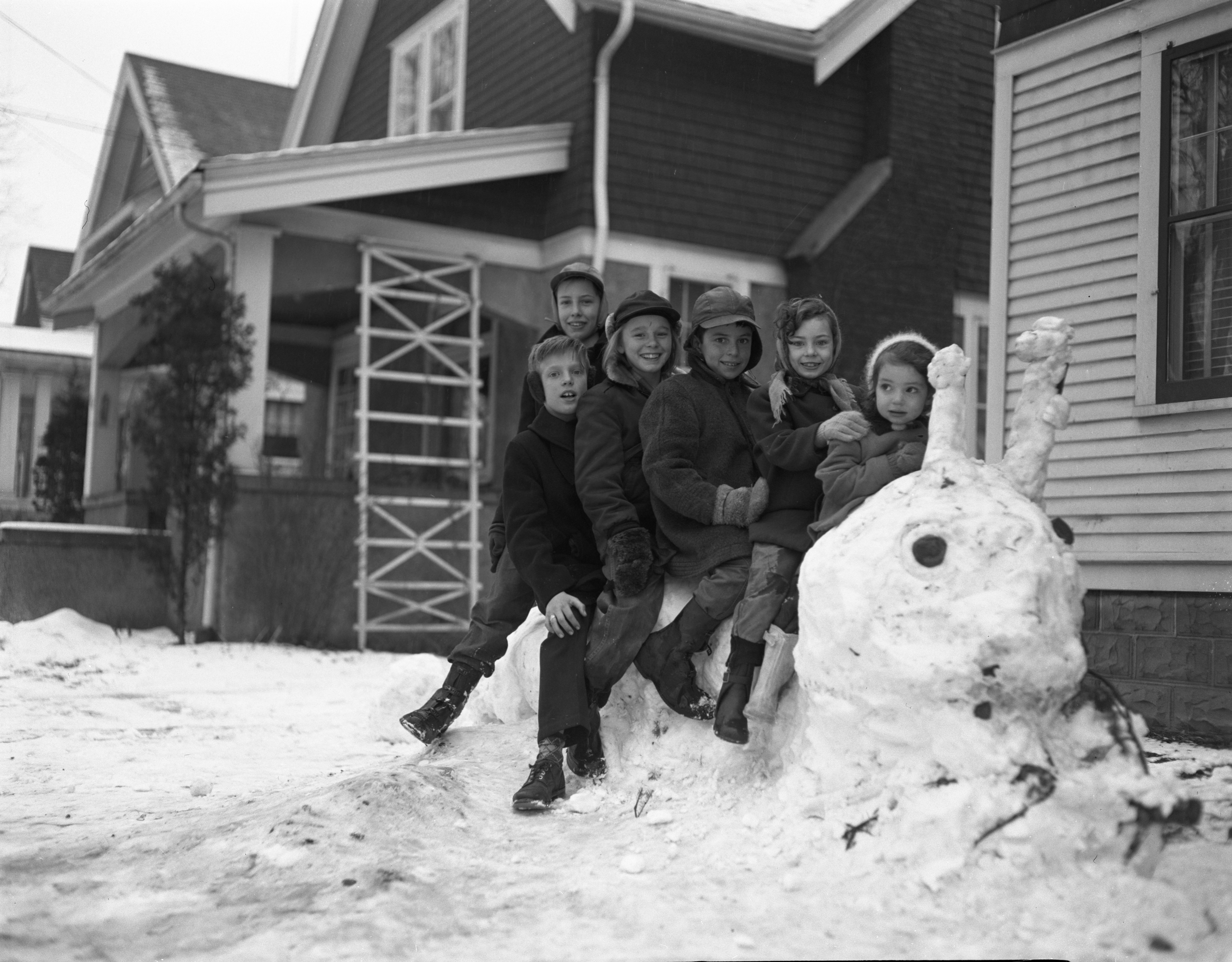Children Ride Snow Caterpillar On Dewey Avenue, January 1952 image