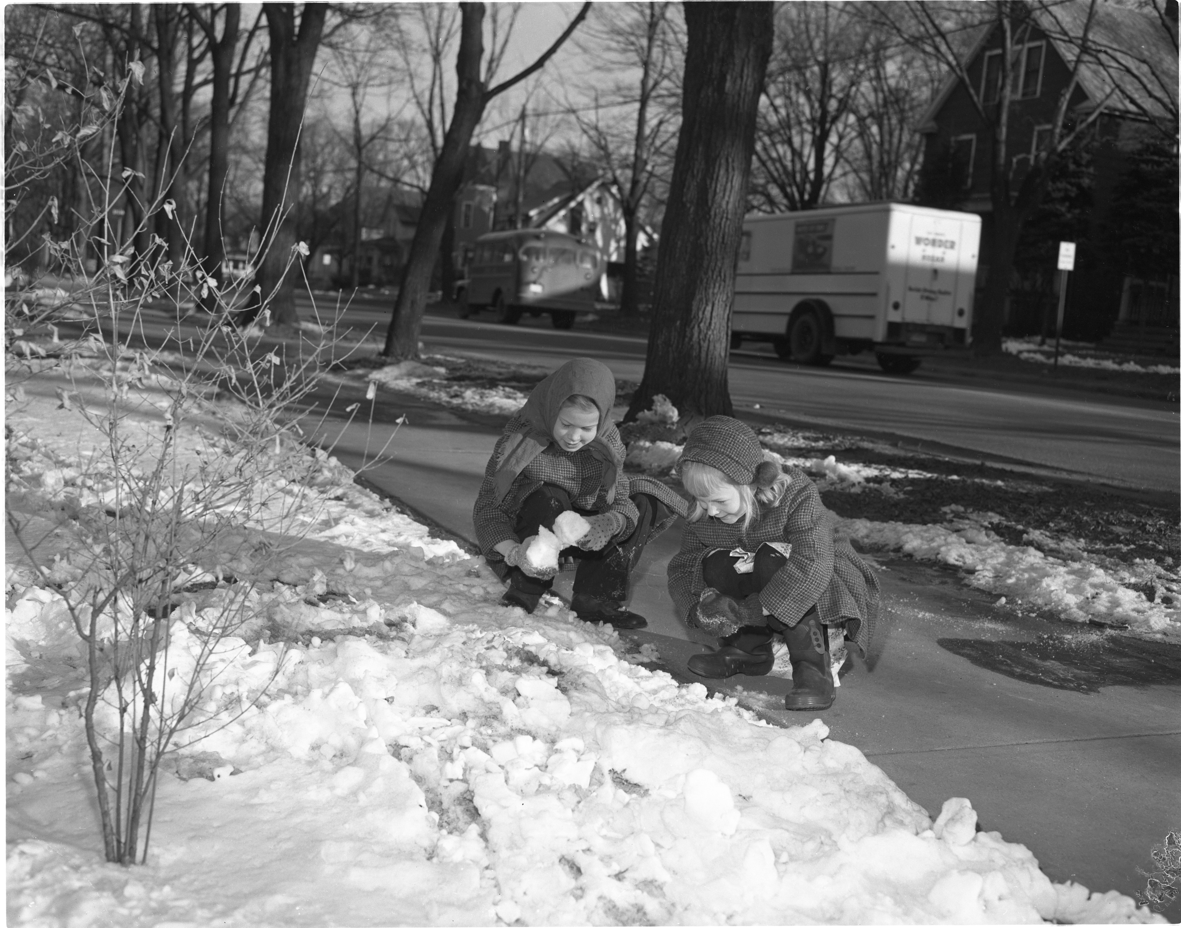 Robin & Christine Bailey Pack Snowballs On The First Day Of Spring, March 1956 image