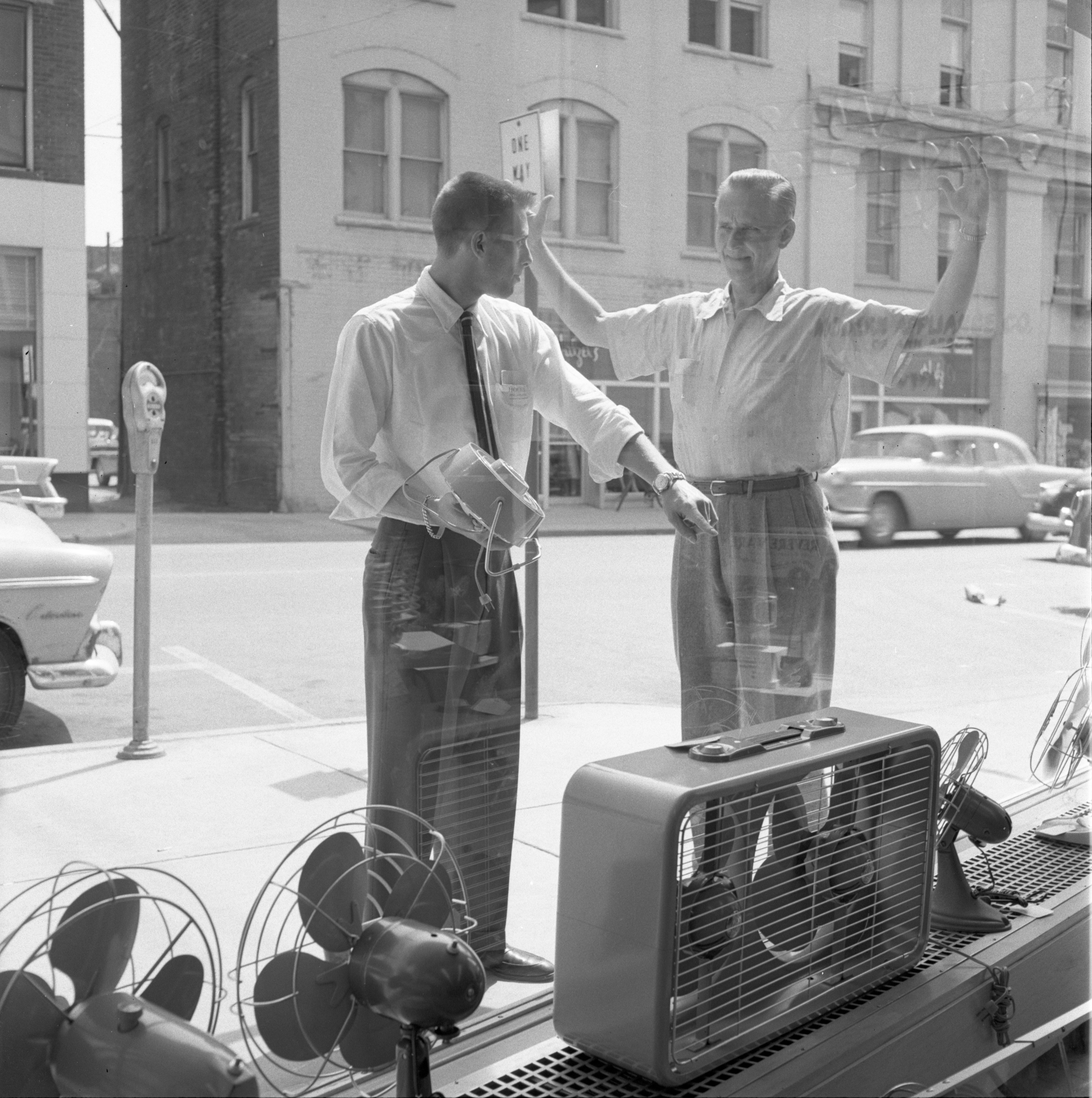 Jeff Rentschler & Coleman Mummery Outside The Hoover Co. Store - 115 E. Liberty Street, June 1956 image