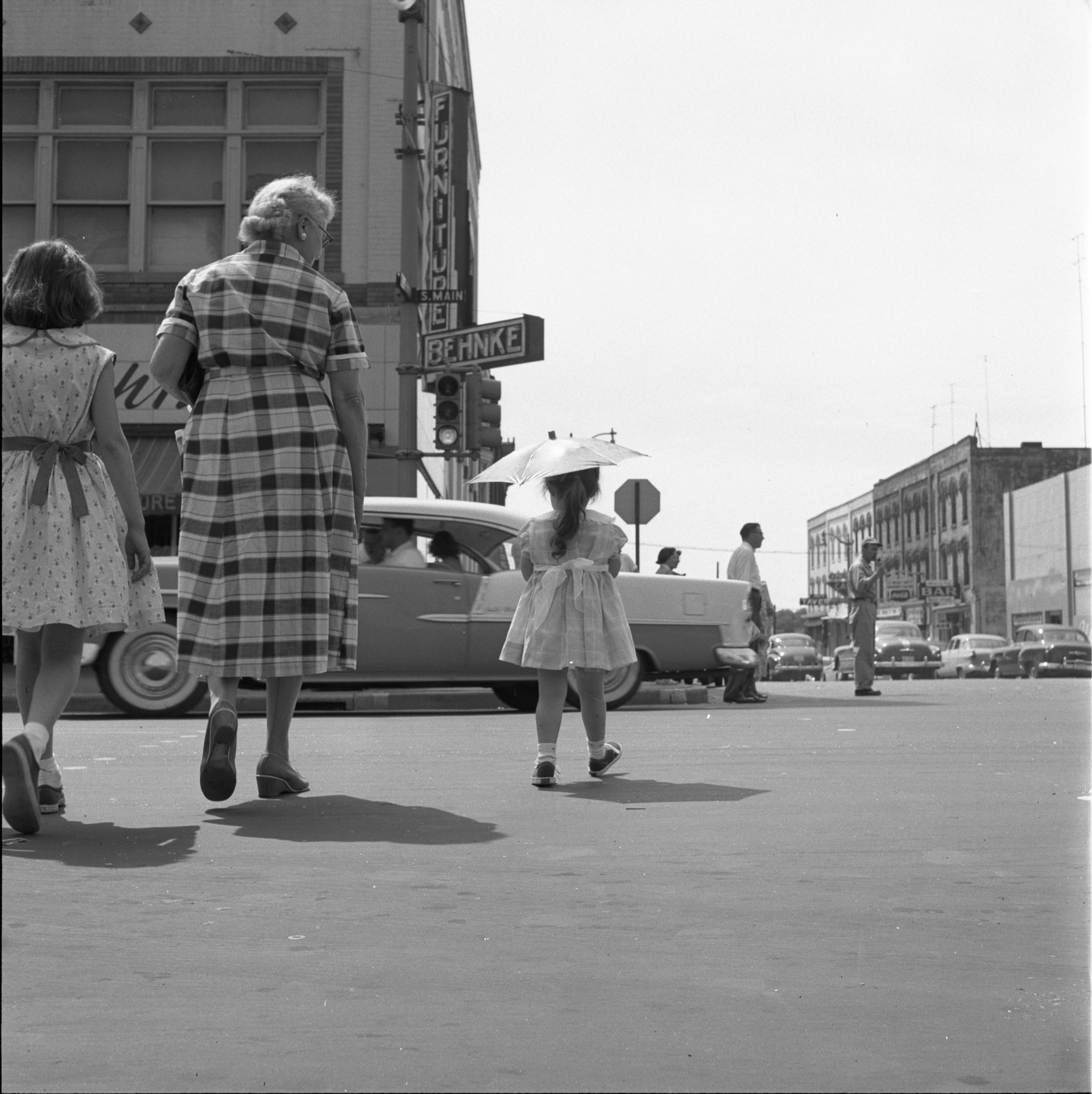 Pedestrians At The Main St - Liberty St Intersection On A Hot Summer Day, June 1956 image