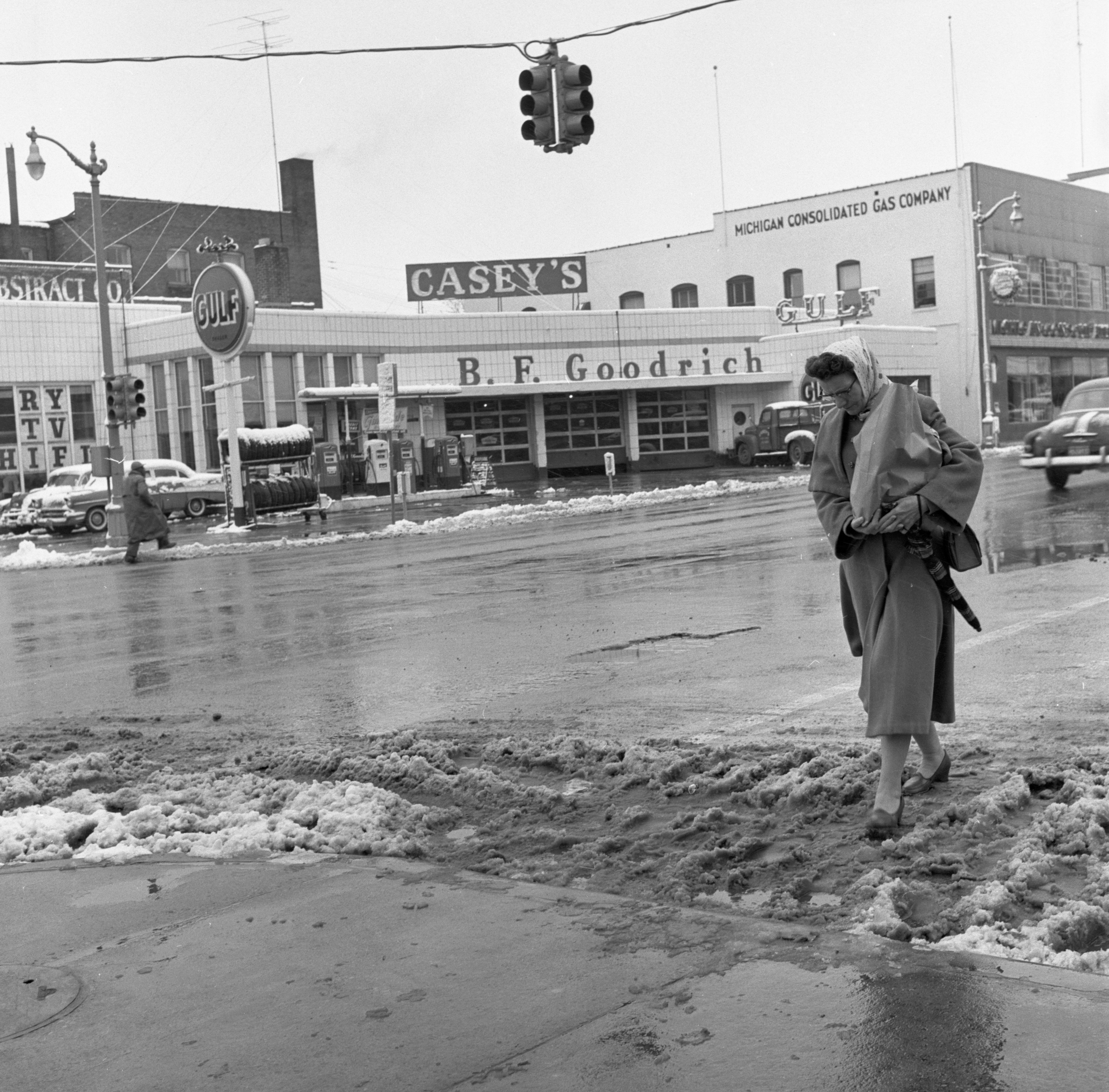 A Pedestrian Crosses Fourth Avenue After A Snowfall, December 1957 image