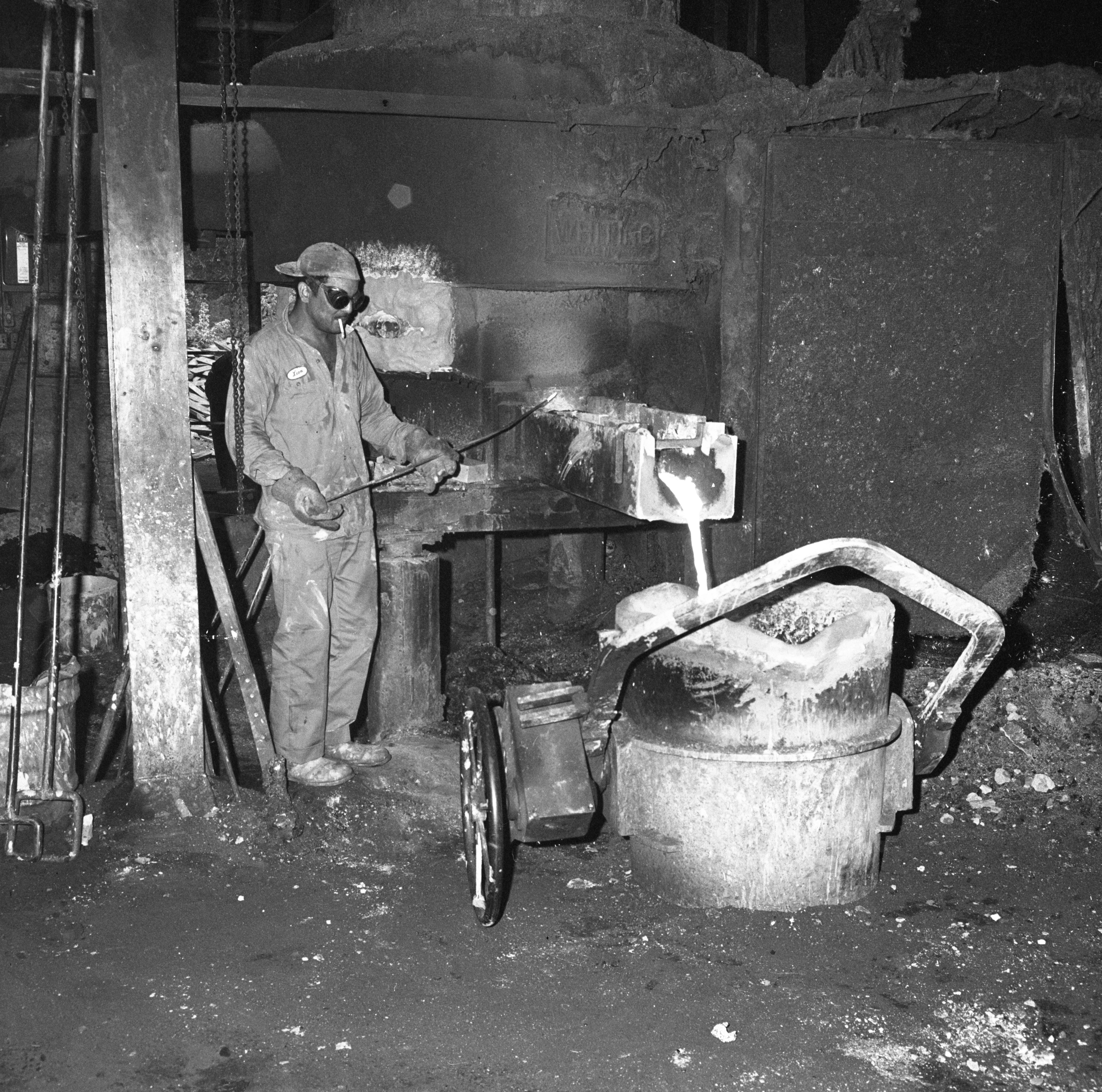 Employees Work With Molten Metal At The Ann Arbor Foundry, August 1964 image
