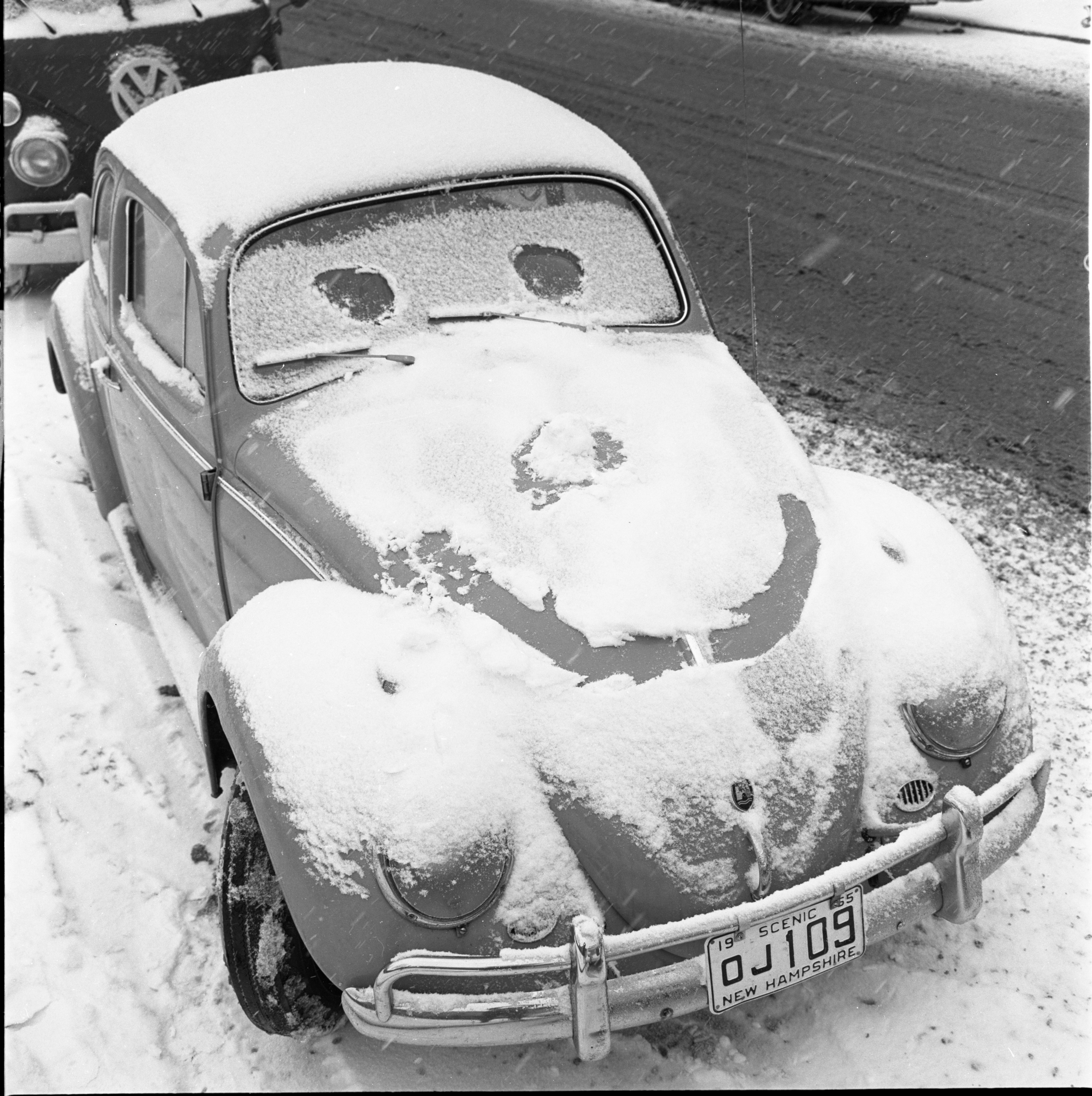 Smiling Snow-Covered Volkswagen Beetle, January 1966 image