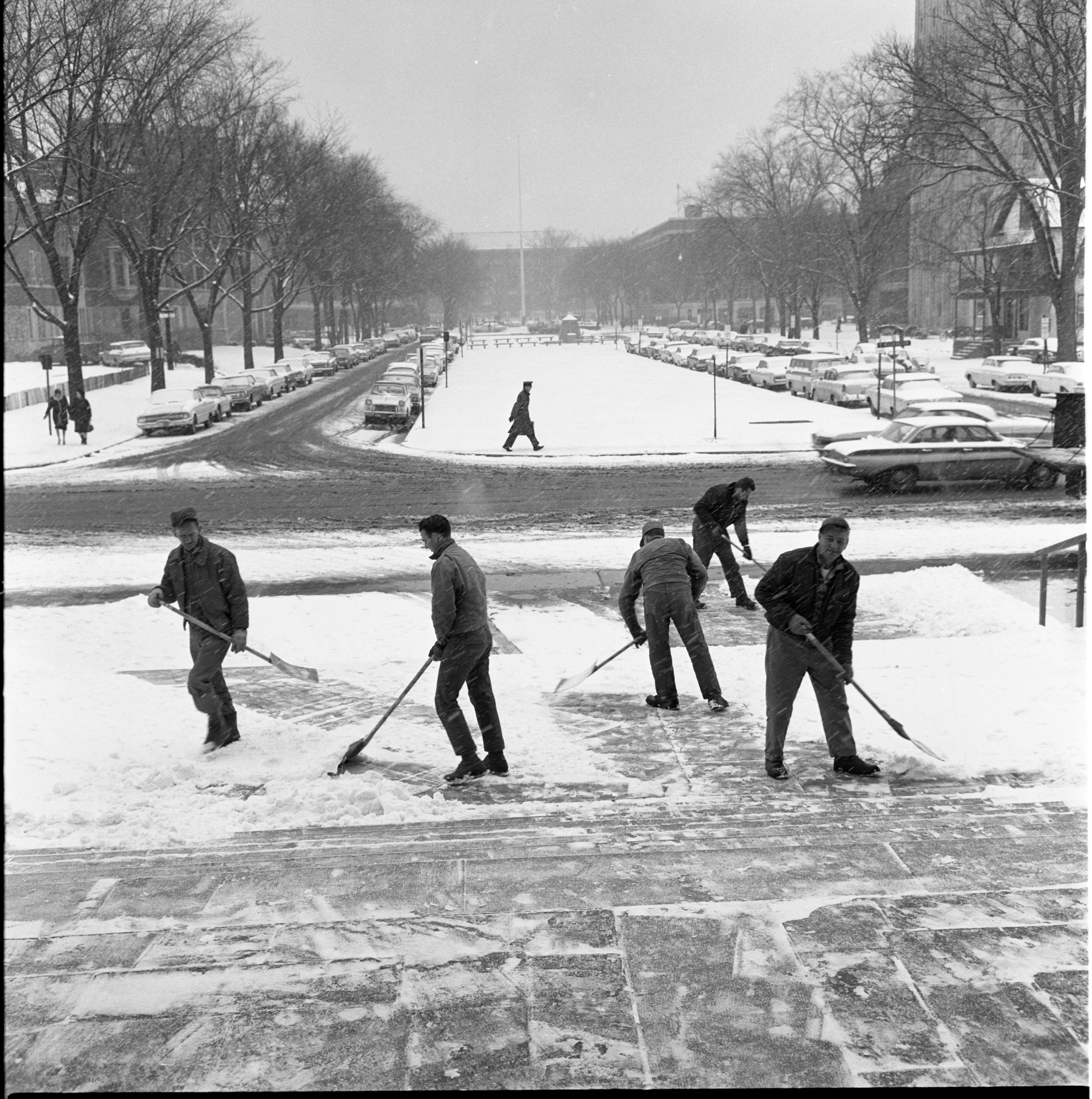 University of Michigan Employees Clear Snowy Campus Sidewalks, January 1966 image