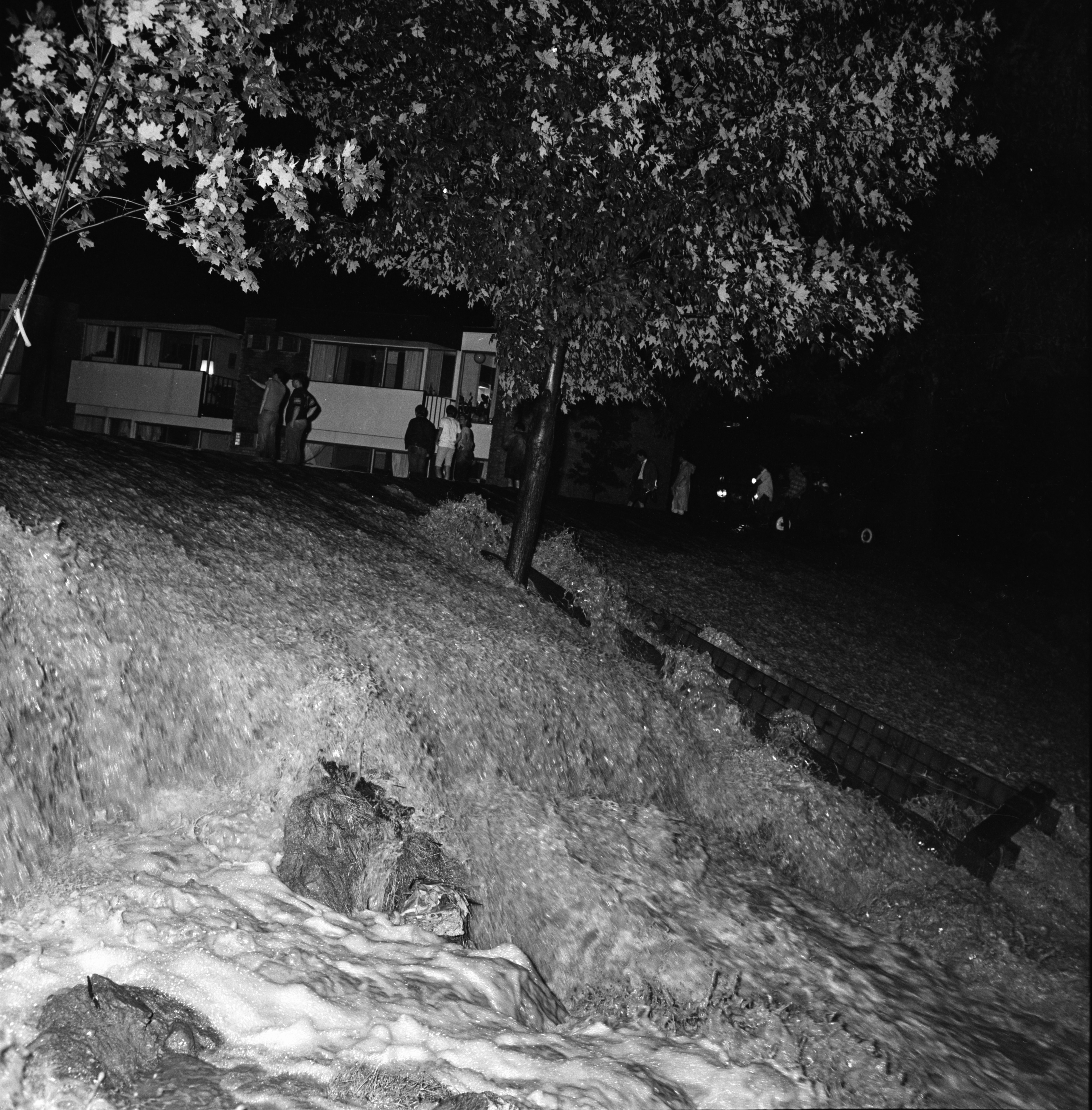 Water pours down a hill at Brookside Apartments on Plymouth Rd, June 1968 image
