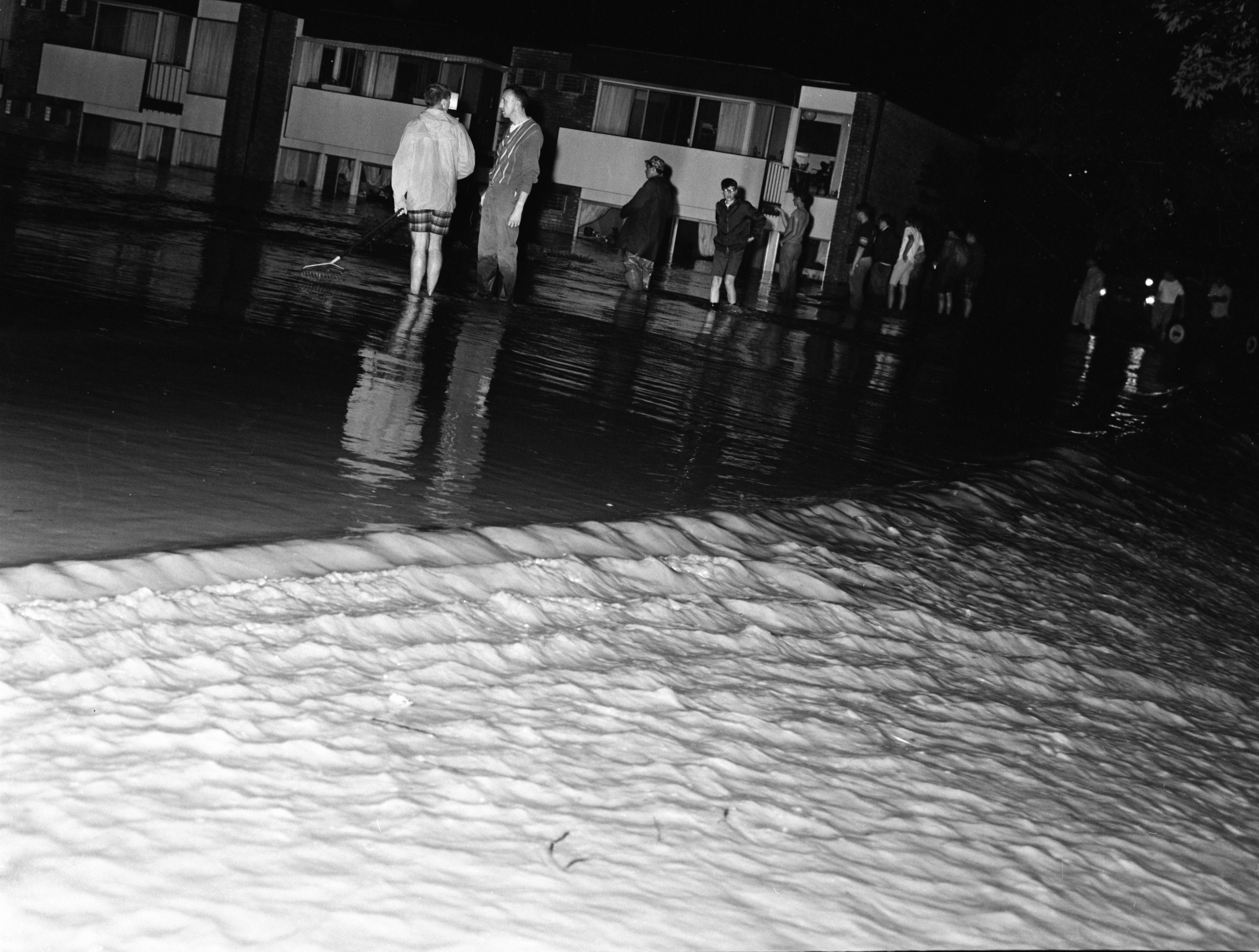 Residents of Brookside Apartments negotiate floodwaters, June 1968 image