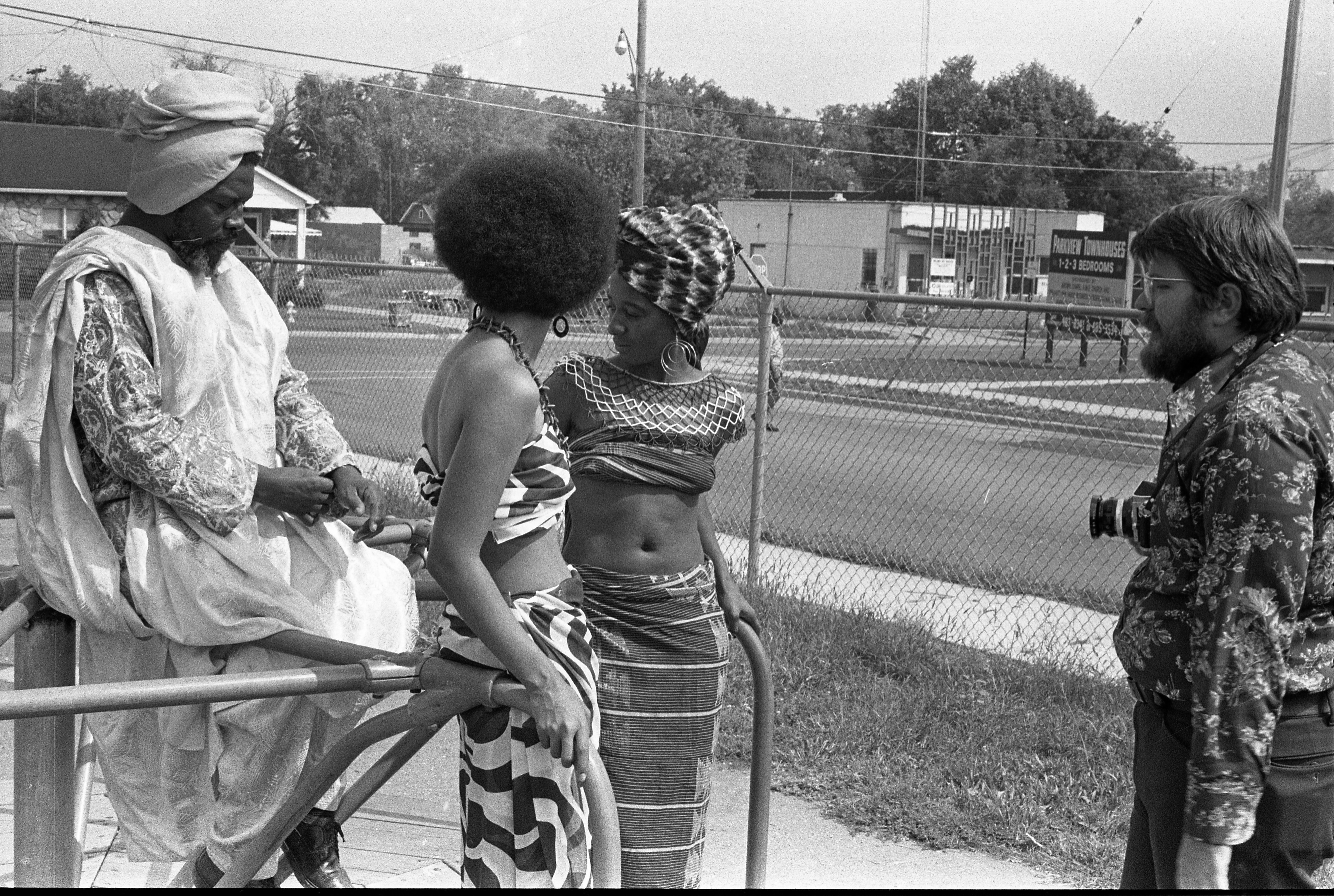 Black Arts Fair Models In Costume With Photographer, September 1972 image