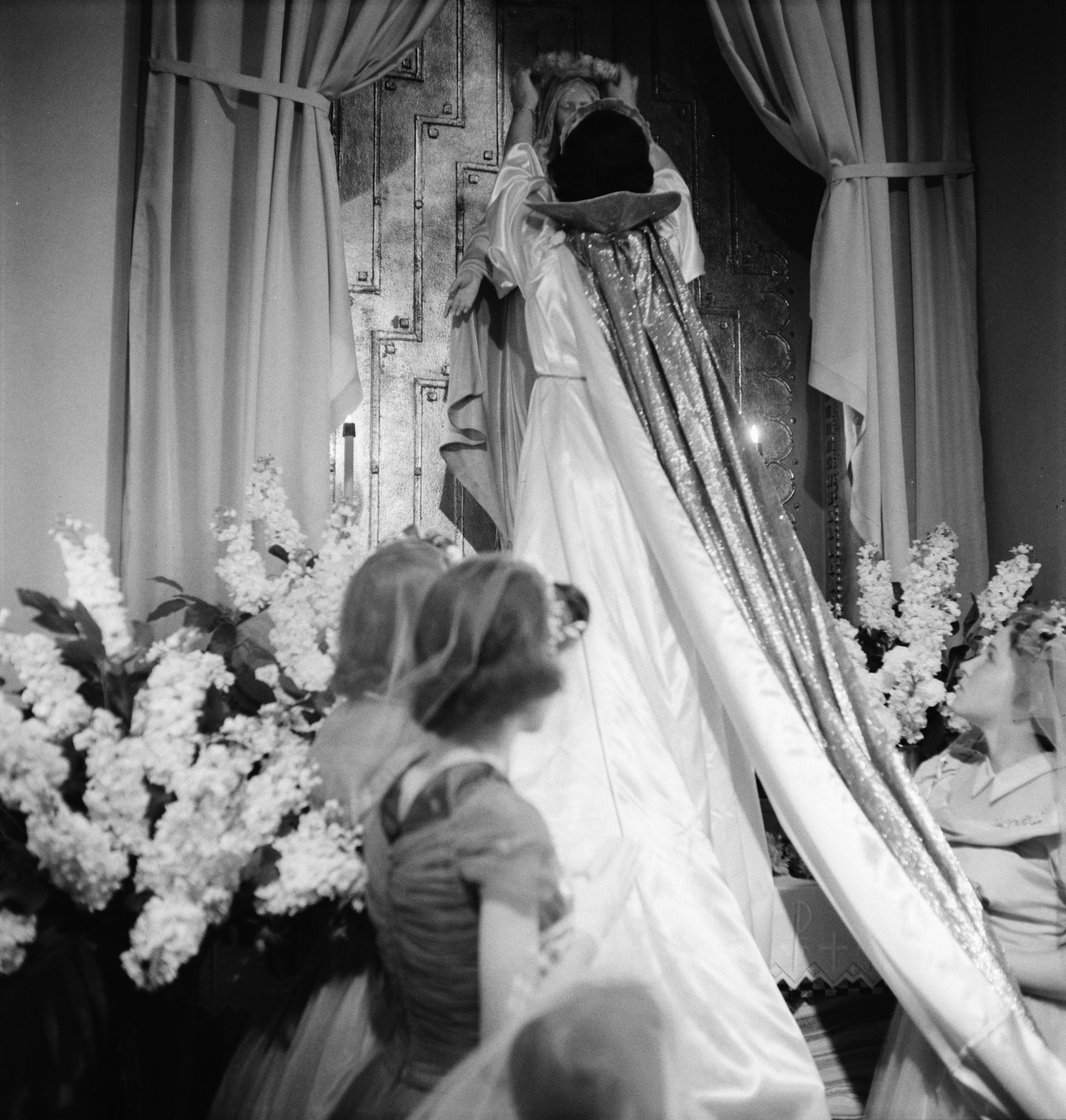 Bonnie Samar Places The Crown Of Flowers During The May Crowning Ceremony at St. John's Catholic Church In Ypsilanti, May 1957 image