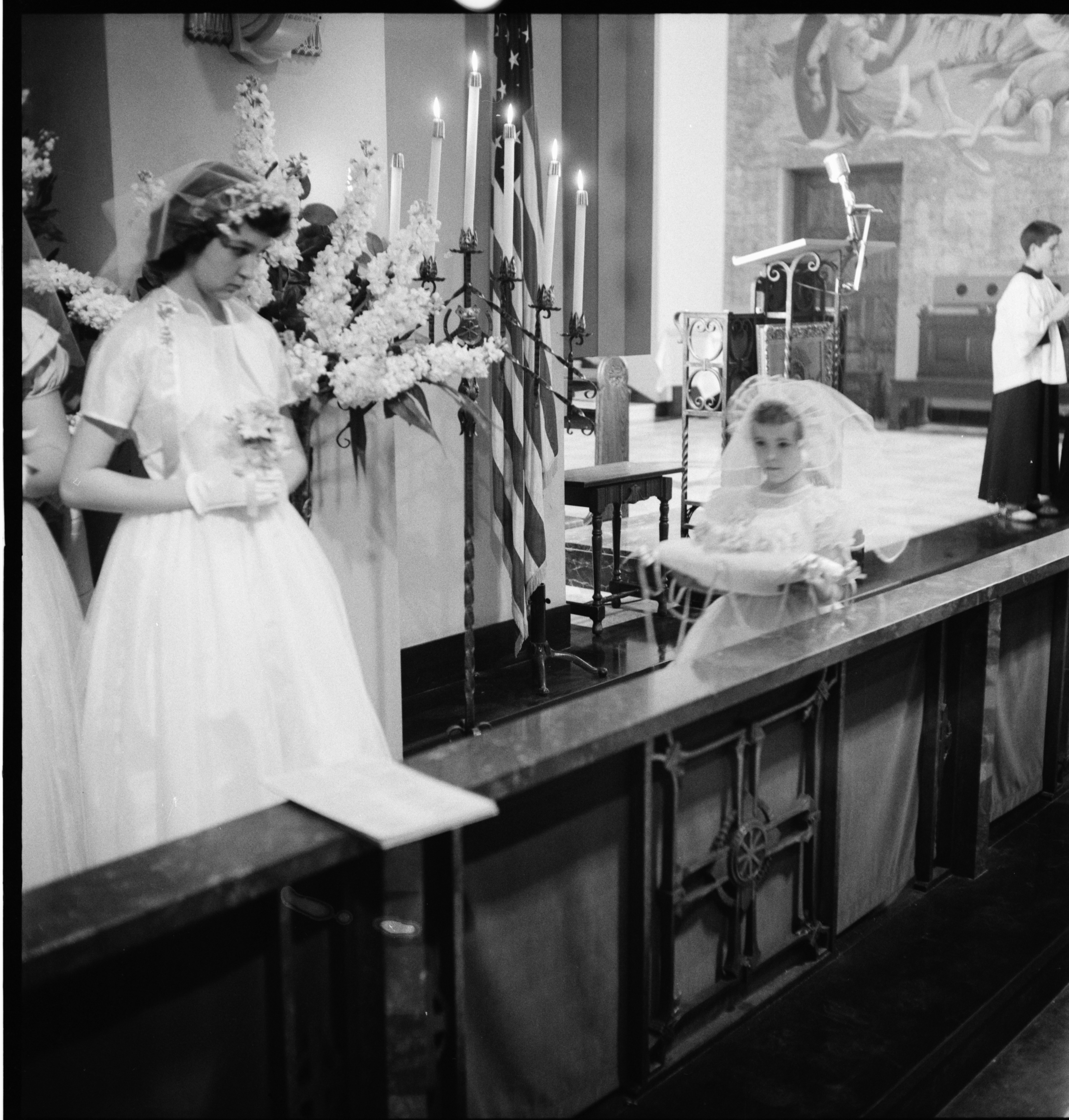 The Crown Of Flowers Is Carried In During The May Crowning Ceremony at St. John's Catholic Church In Ypsilanti, May 1957 image
