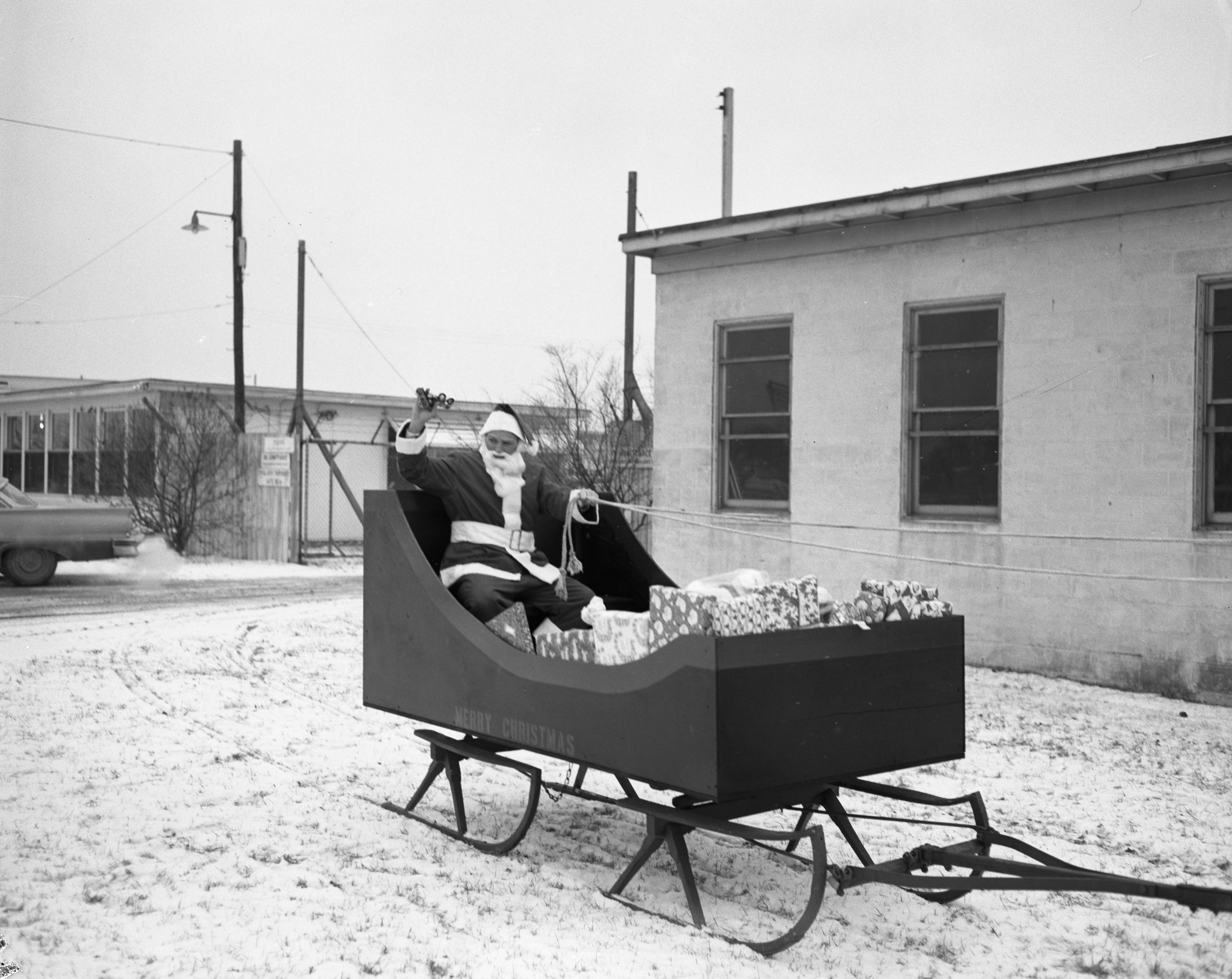 Santa in Sleigh Delivers Packages to Needy Families, December 1959 image