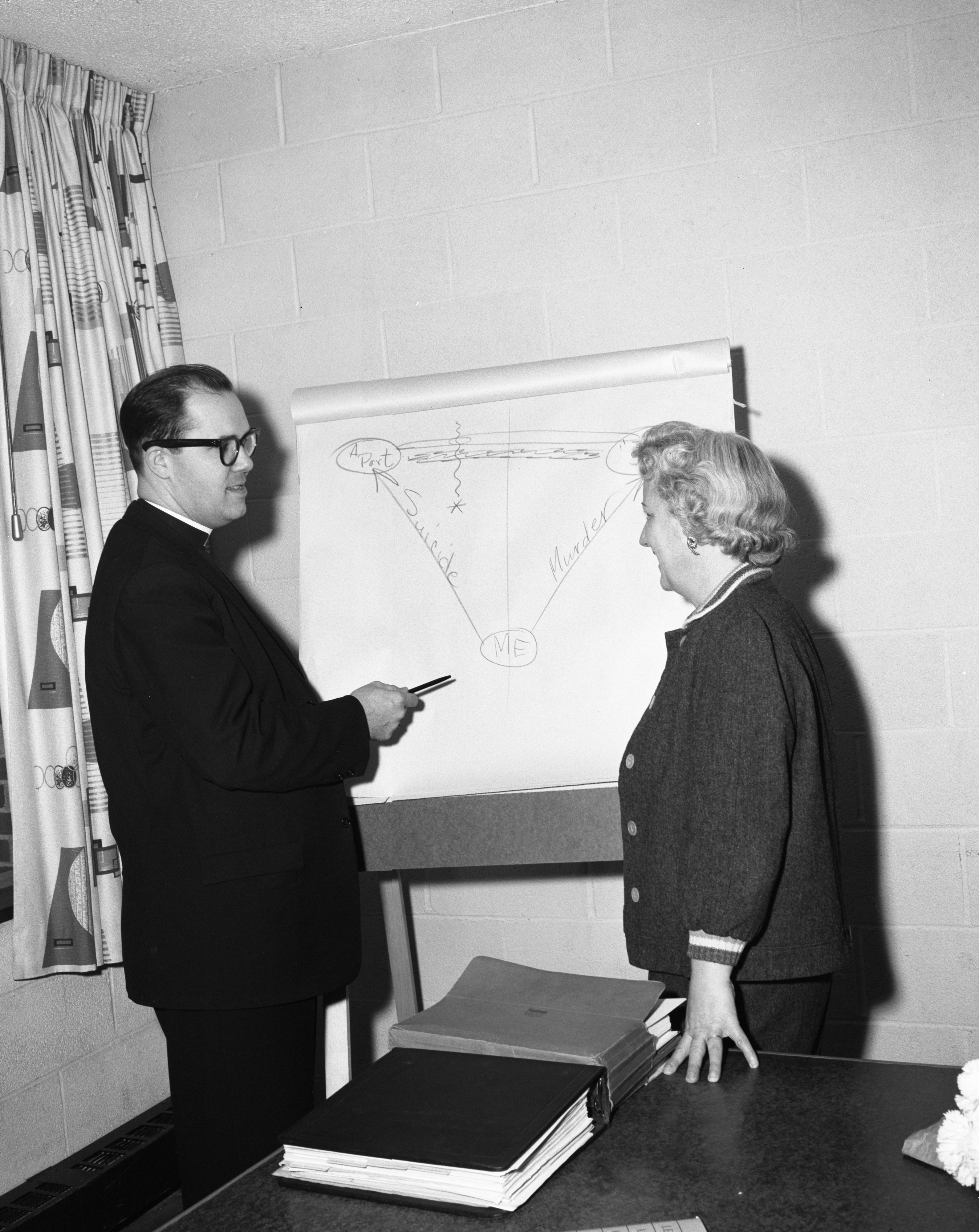 Rev. Donald Bodley & Mrs. Thomas Lyndon Look at Chart, March 1960 image