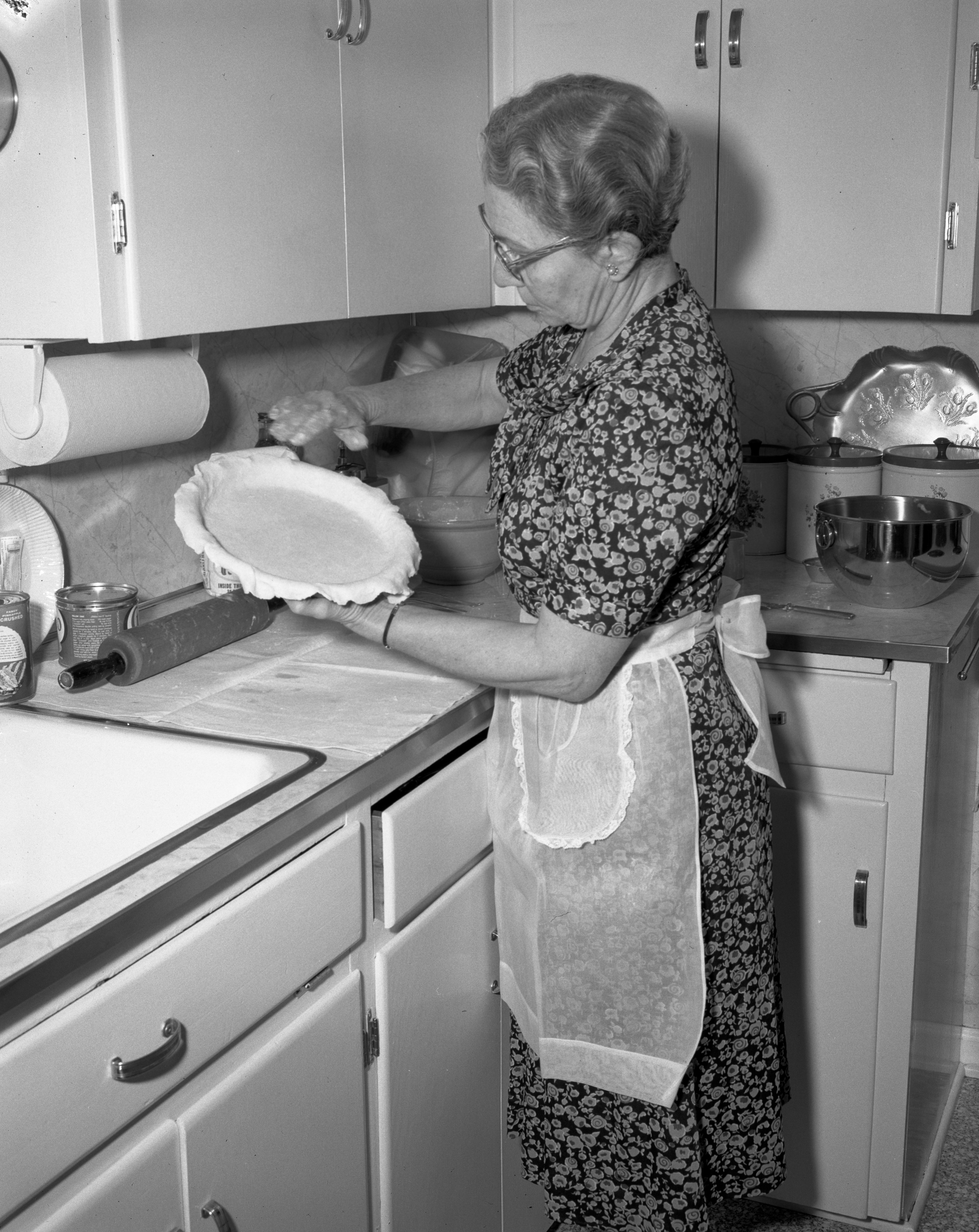 Mrs. Glenn Groosbeck Bakes Apple Pies for Ypsilanti United Church Women's Bake Sale, April 1961 image
