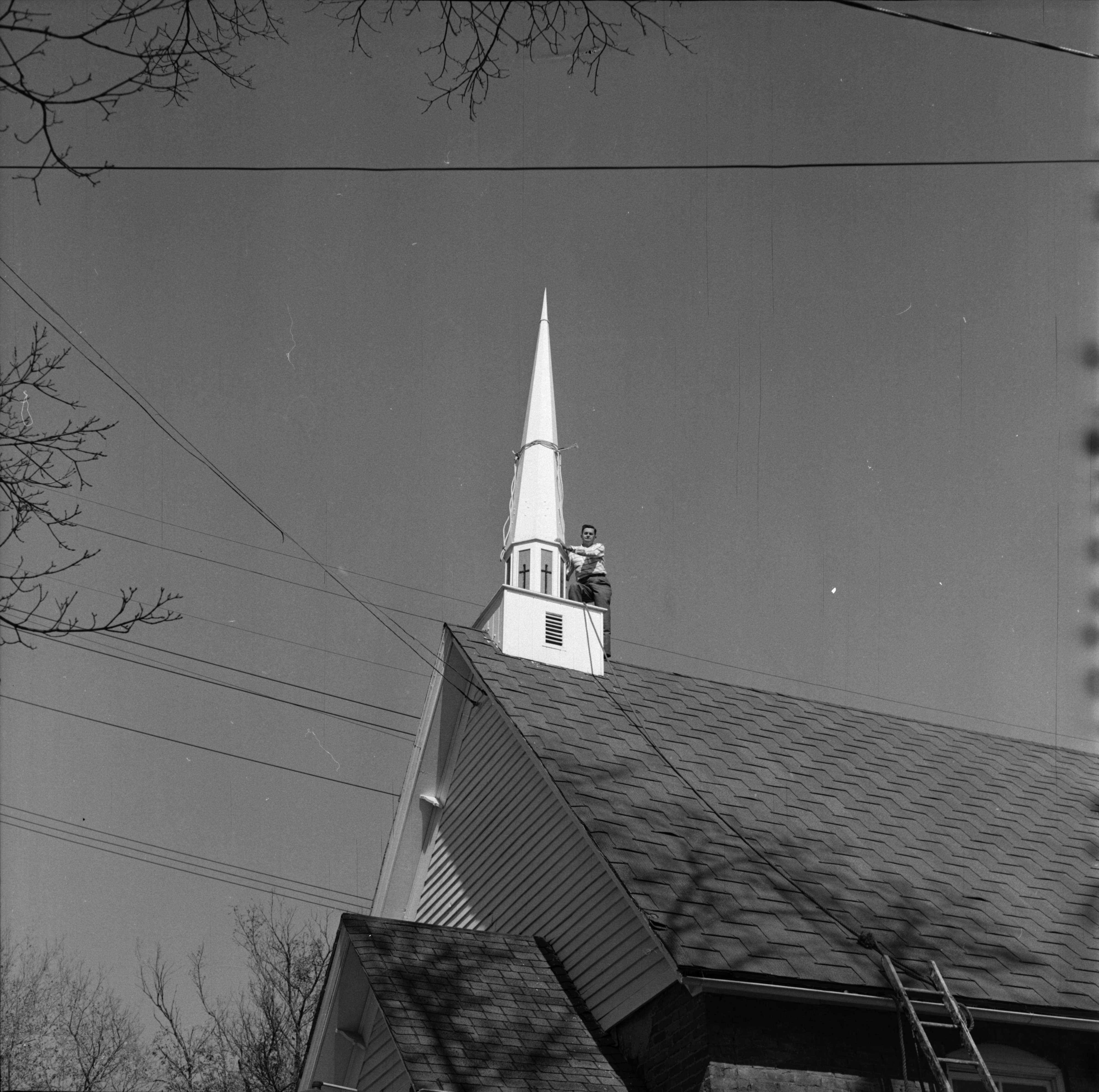 Parishioner Assists Helicopter with Steeple Installation at Bethesda Bible Church, Ypsilanti, October 1963 image