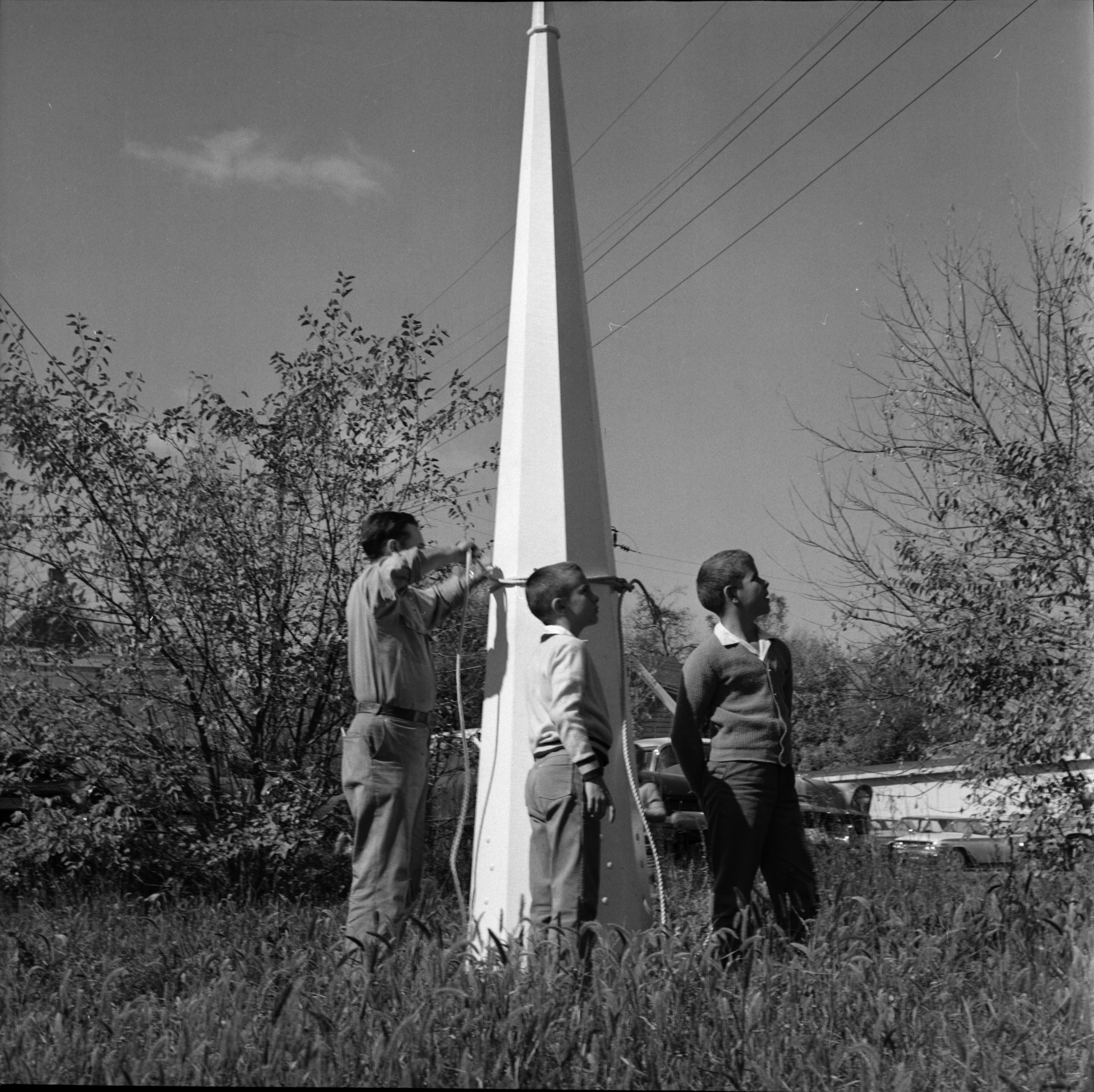 Three Parishioners Stand with Wooden Steeple at Bethesda Bible Church, Ypsilanti, October 1963 image