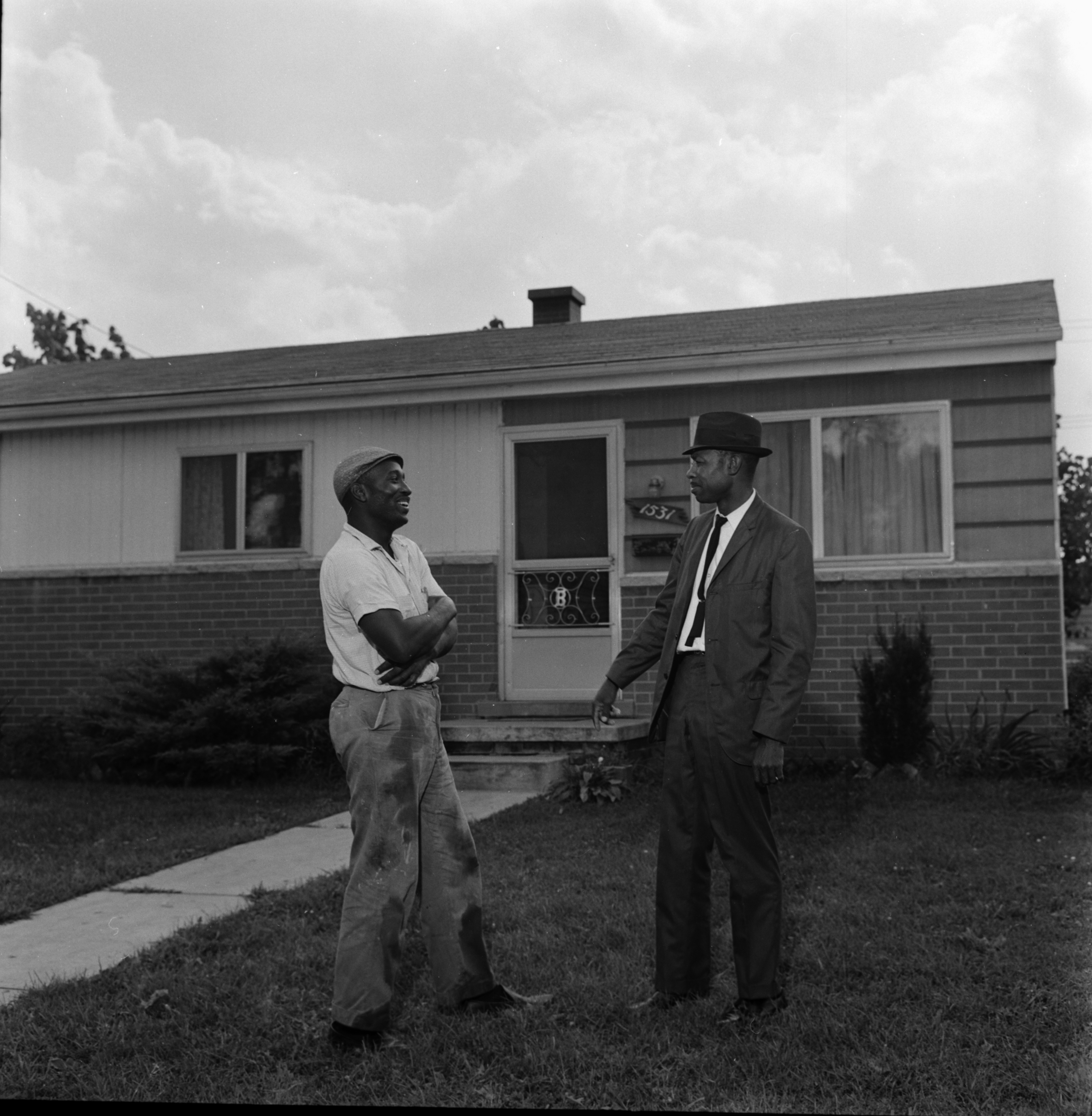 Elray Lipsey and Pastor Elder L. Edwards Inspect House owned by Christ Temple Apostolic Faith Church of Ypsilanti, August 1965 image
