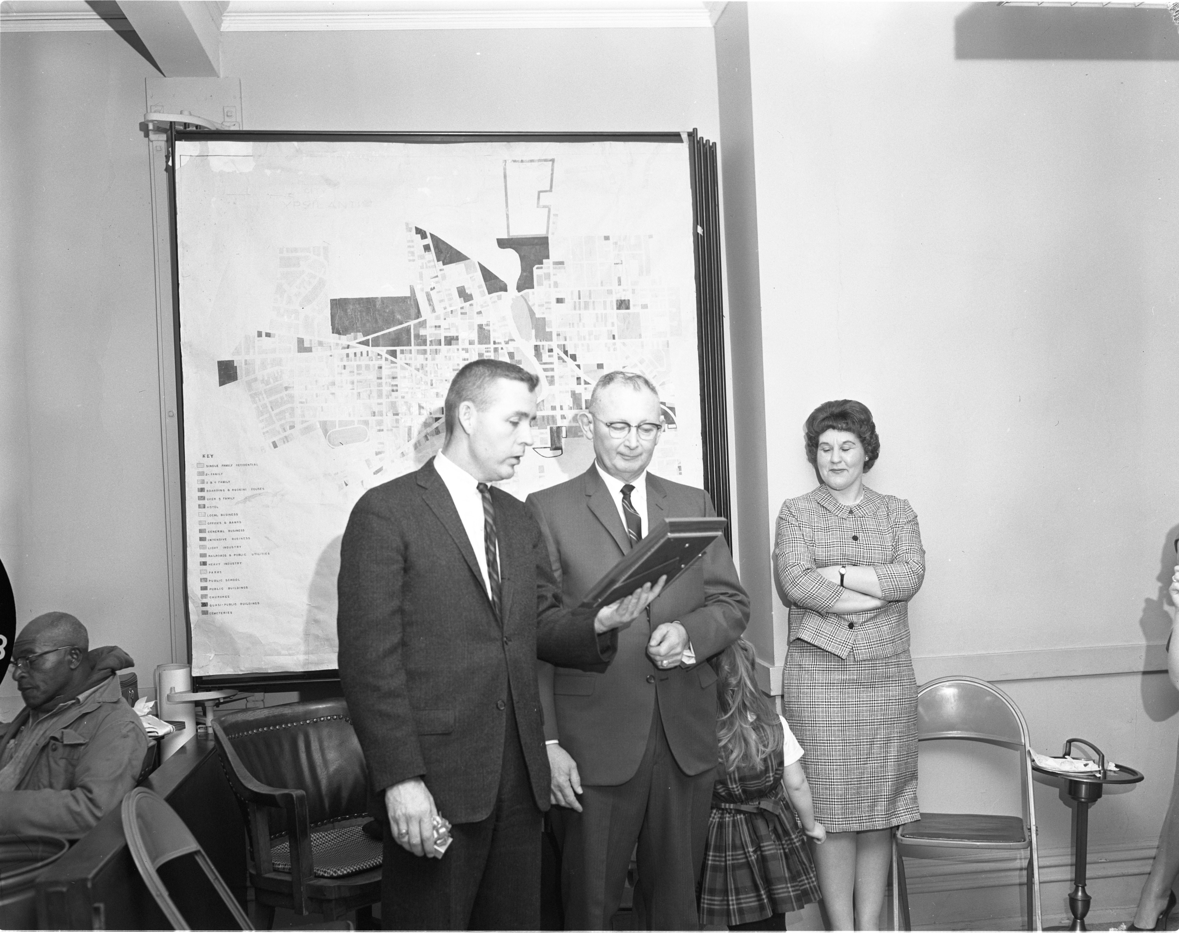 Ypsilanti Mayor Vincent Buck Presents A Plaque To Retiring Fire Chief Gerald Kelly, March 1965 image