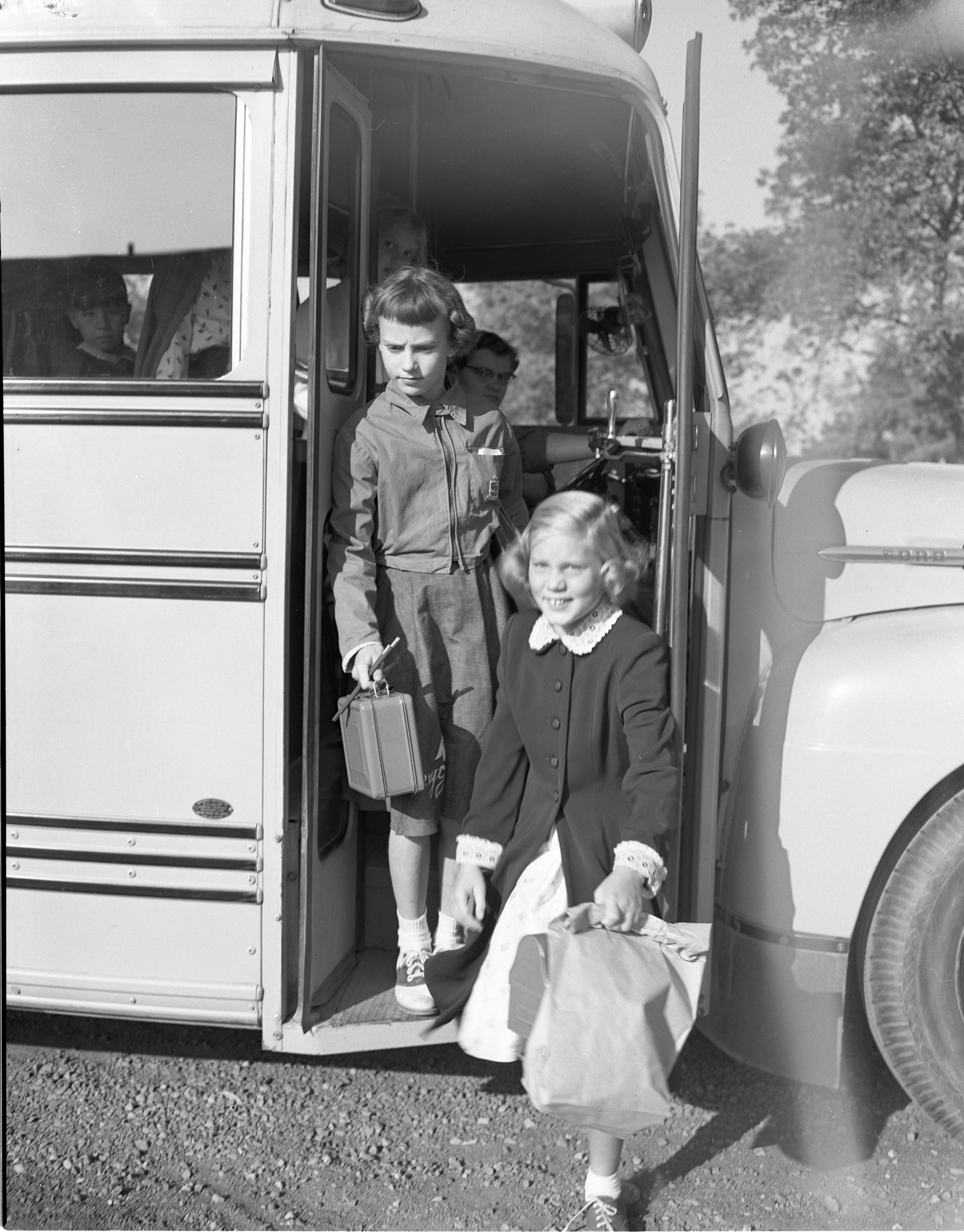 Students Arrive By School Bus On The First Day Of School At Chapelle School, September 1954 image