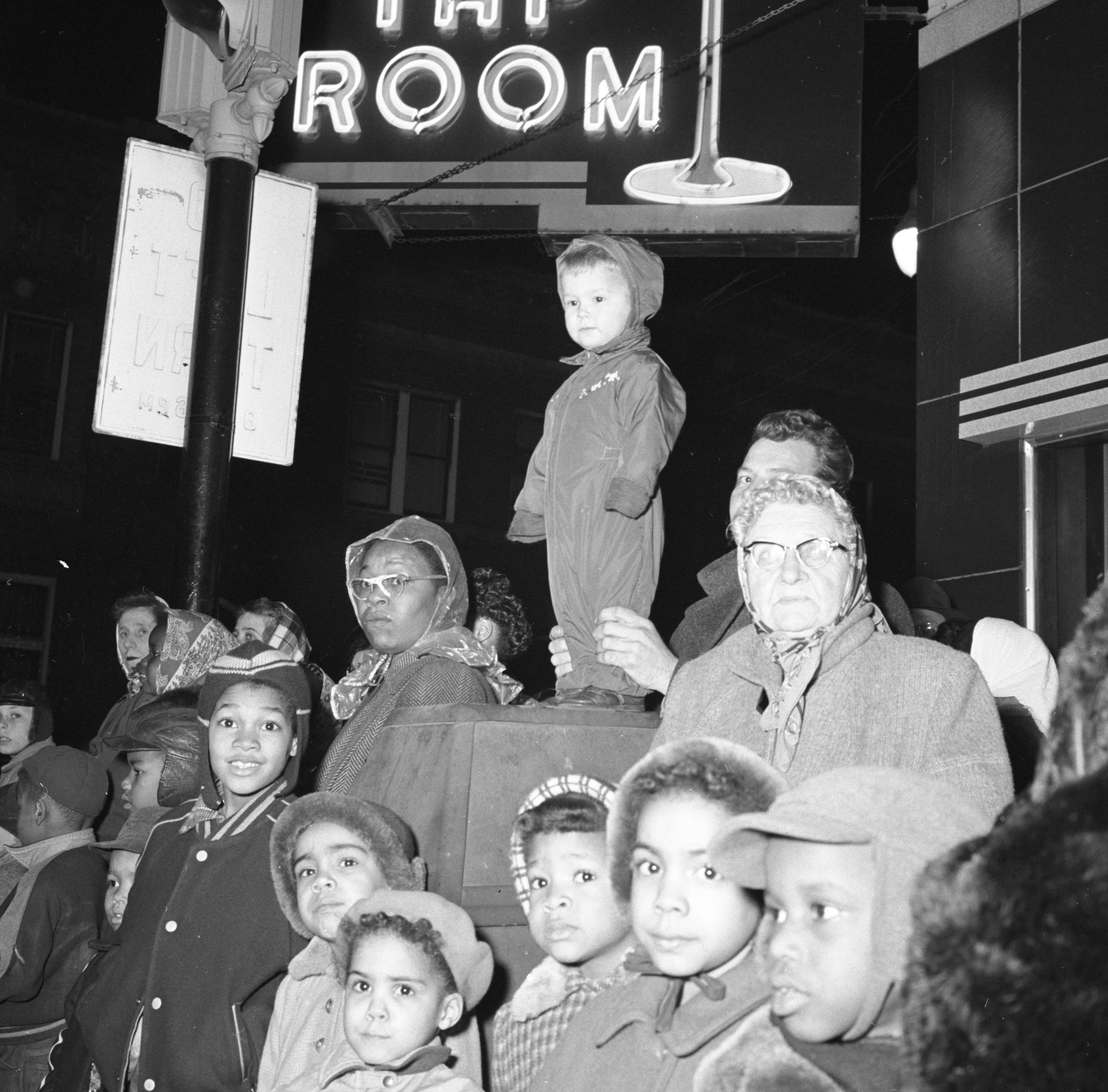 Jeffrey Craig Reed Watches From Atop A Trash Container Along The Ypsilanti Christmas Parade Route, December 1954 image