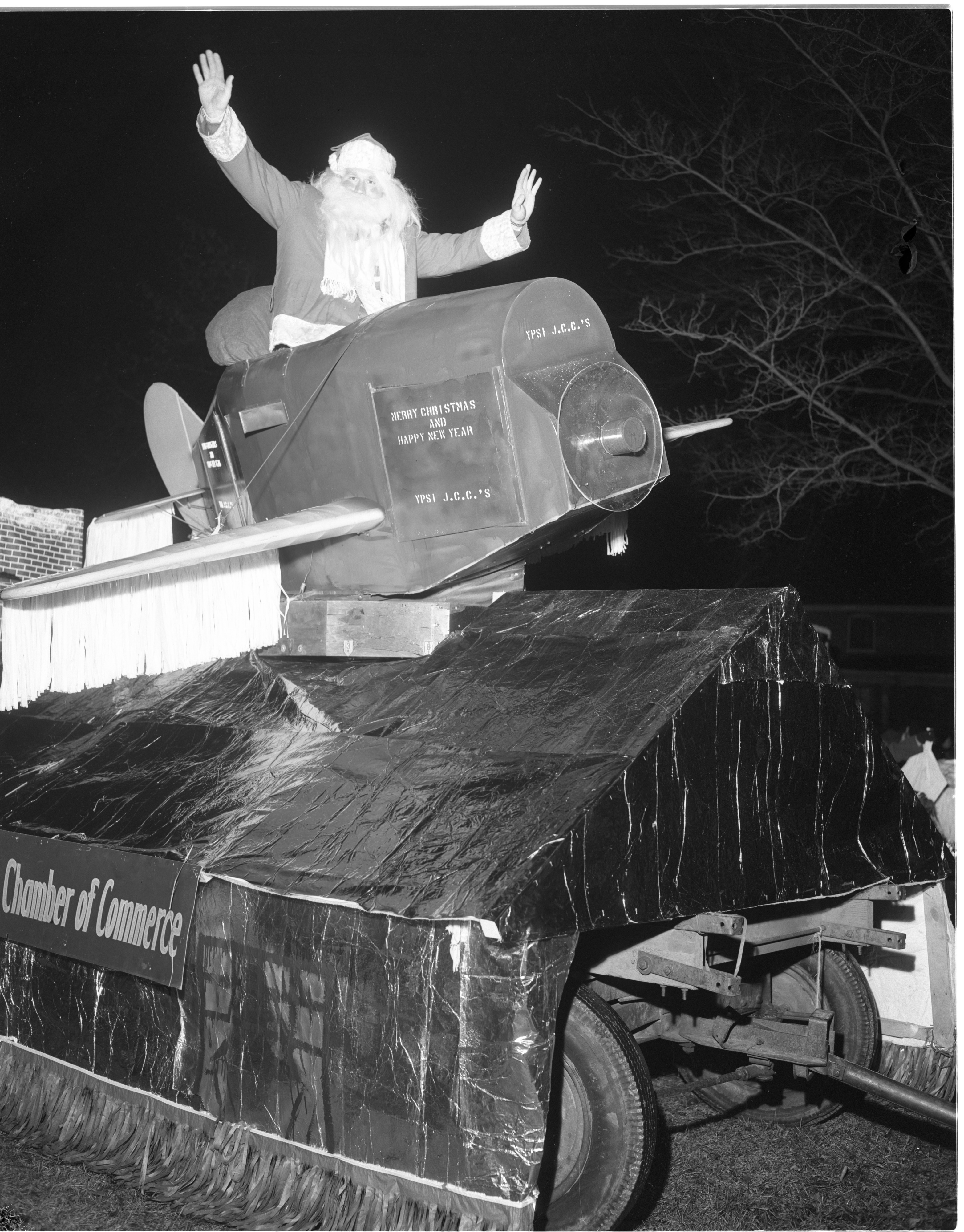 Santa Arrives By Plane In The Annual Ypsilanti Christmas Parade, December 1956 image