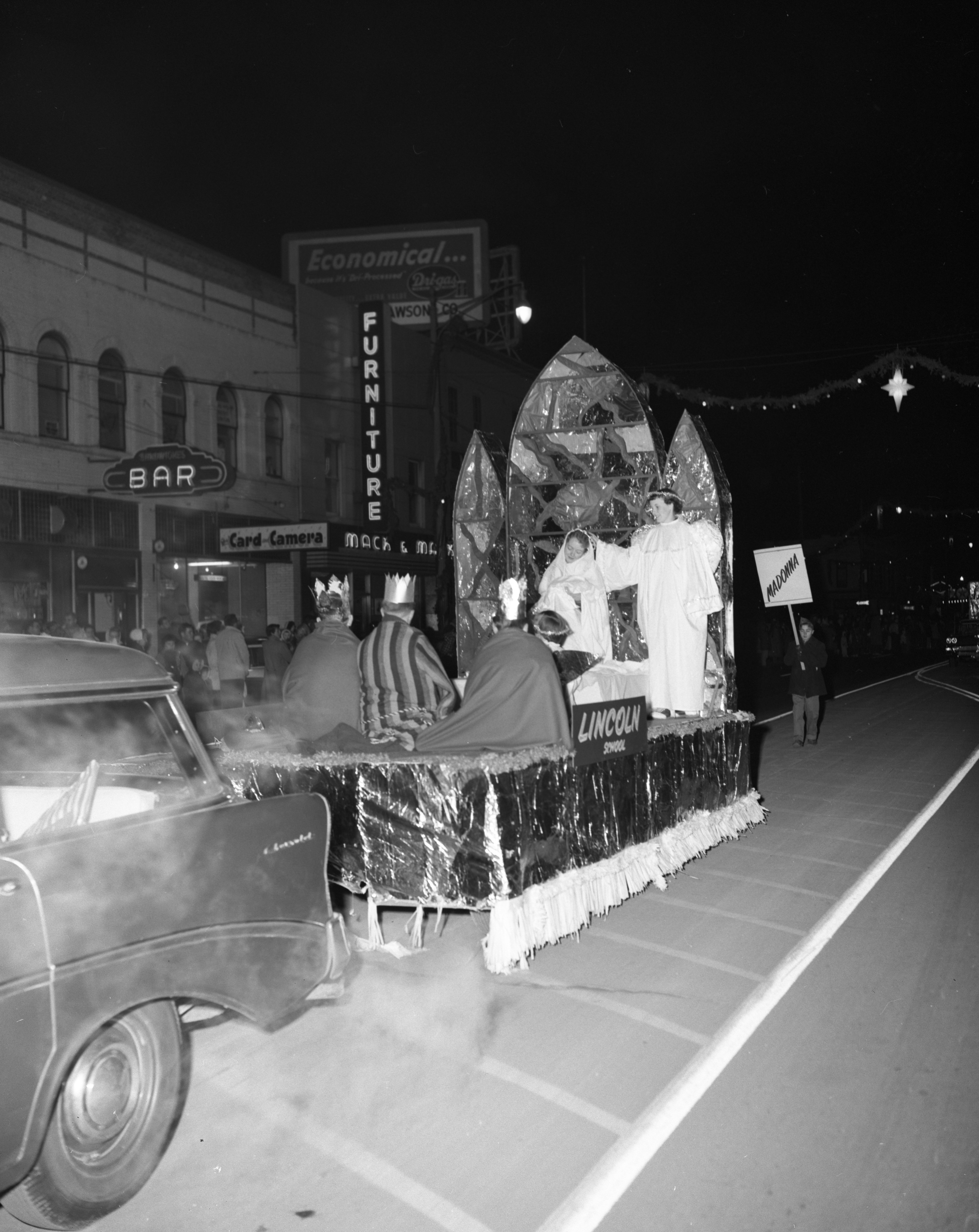 """Guardian Angels"" float, sponsored by Lincoln Consolidated School, Ypsilanti Christmas parade, December 1957 image"