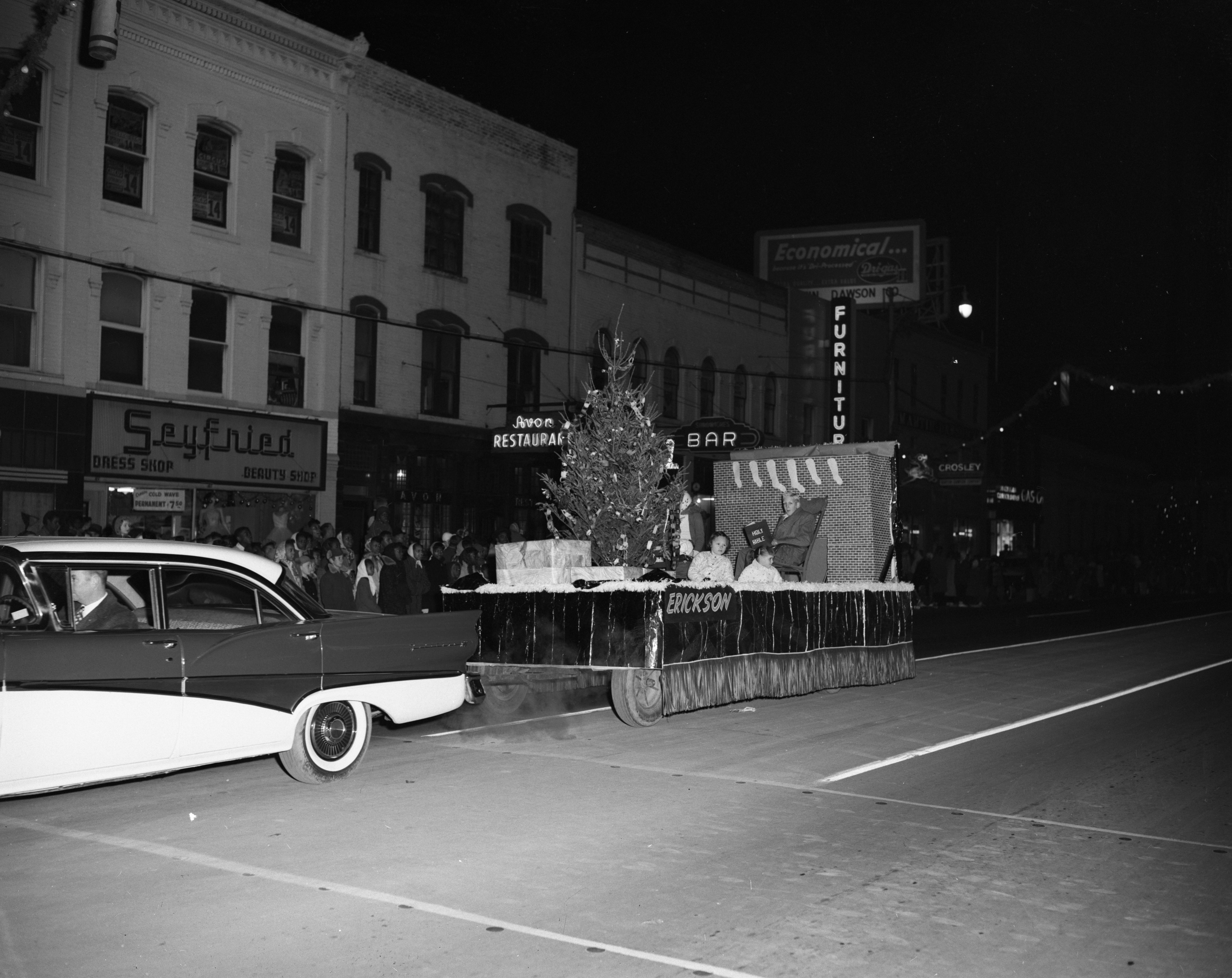 """Christmas Family"" float, sponsored by Erickson Elementary School, Ypsilanti Christmas parade, December 1957 image"