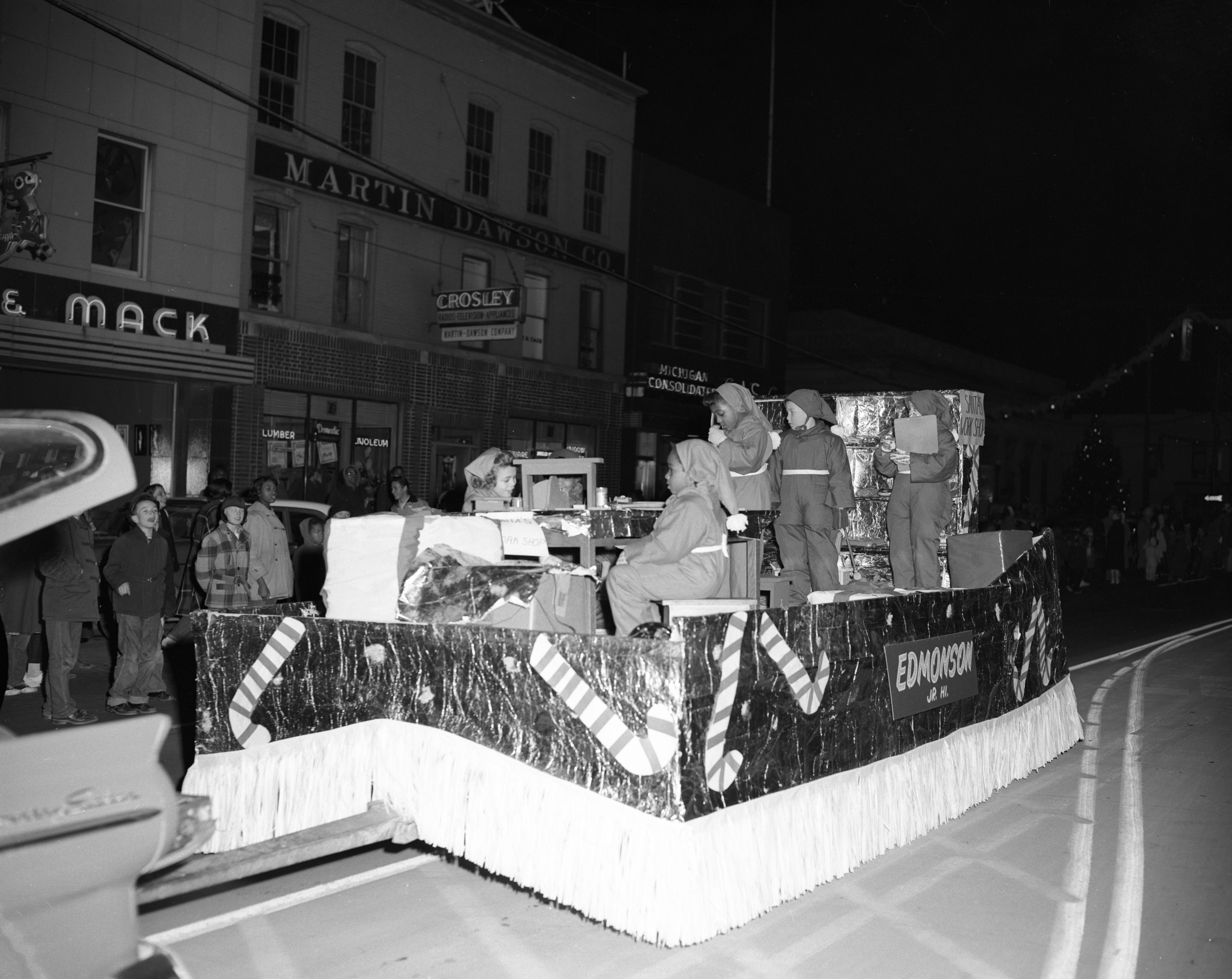 """Santa's Workshop"" float, sponsored by Willow Village's Edmonton Junior and Senior High Schools, Ypsilanti Christmas parade, December 1957 image"