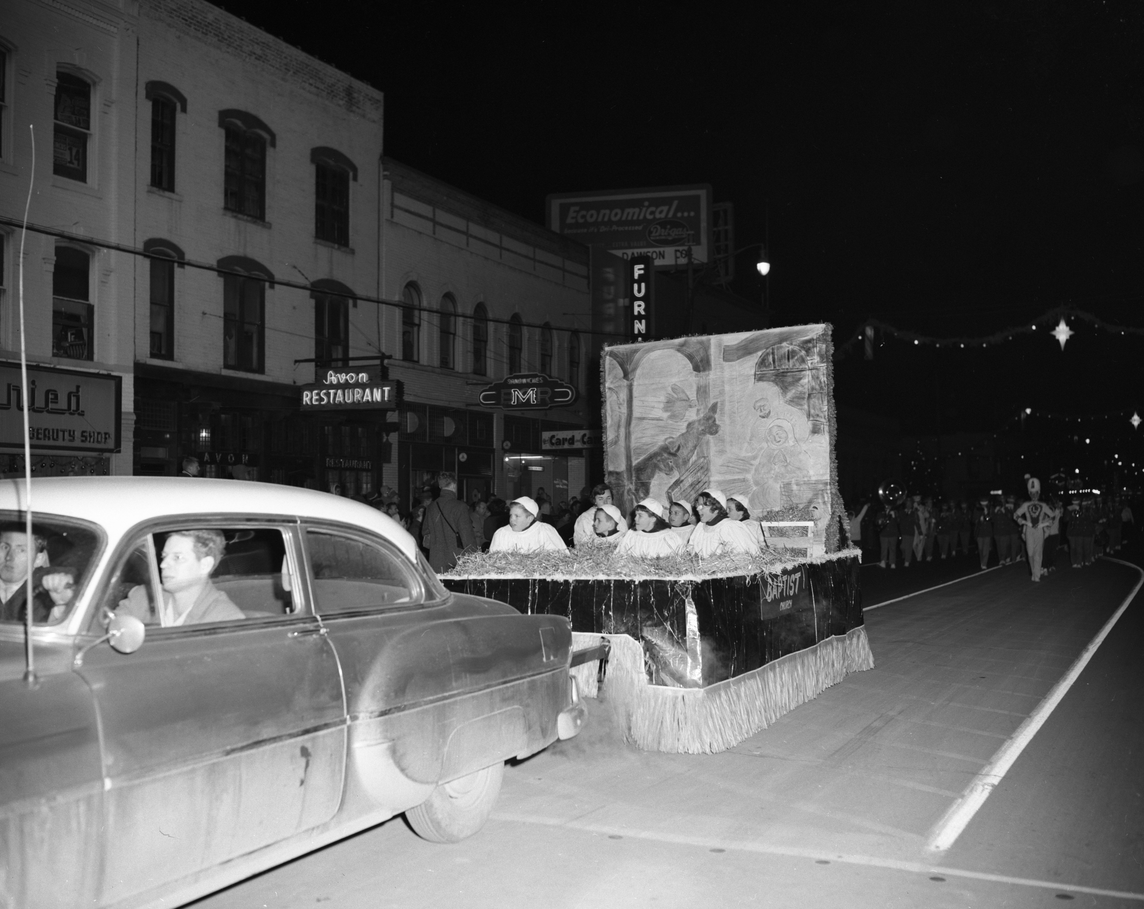 """Away in a Manger"" float, sponsored by First Baptist Church of Ypsilanti, Ypsilanti Christmas parade, December 1957 image"