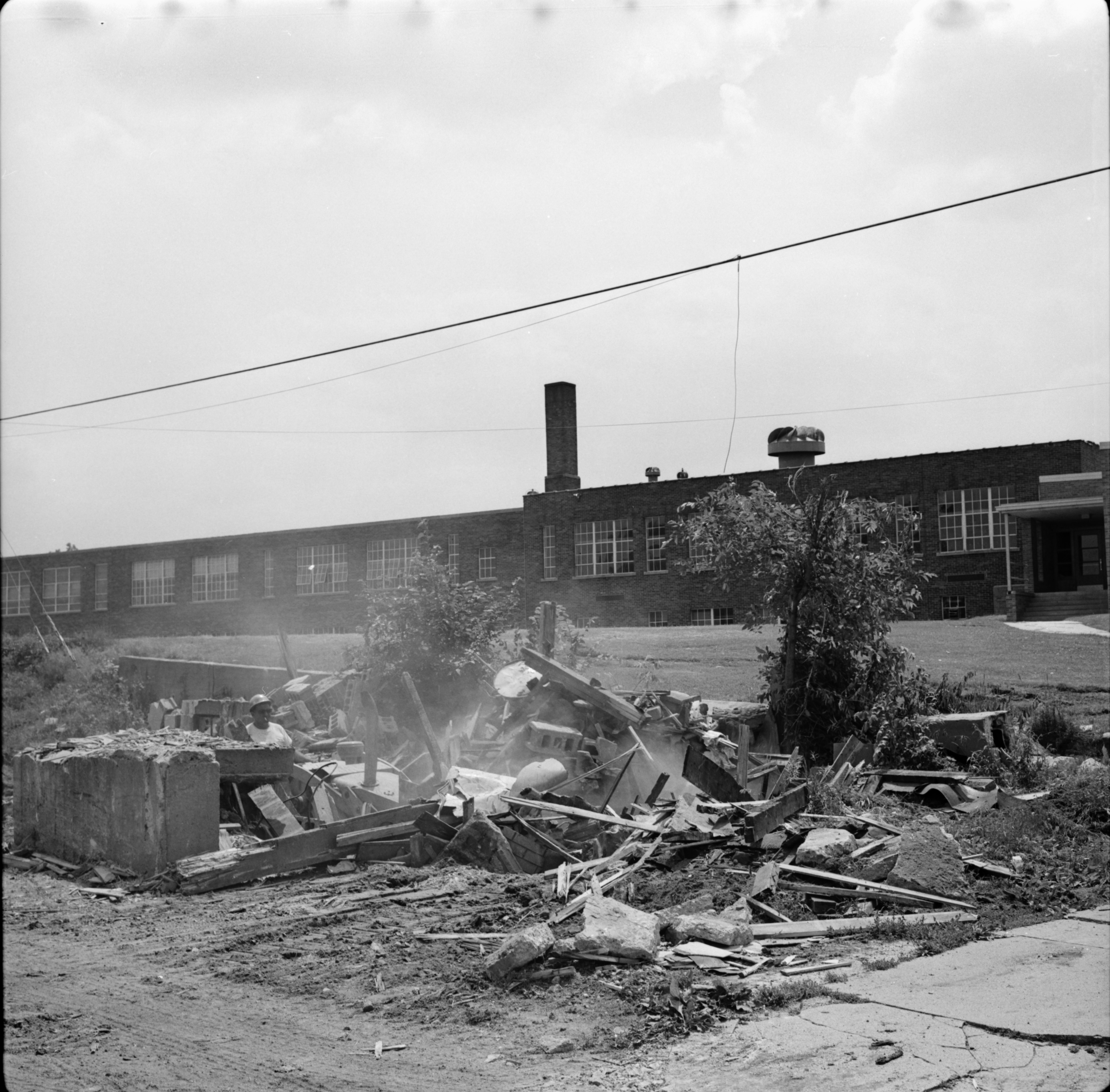 Bulldozer Demolishes Building Near Perry School During Urban Renewal, June 1967 image