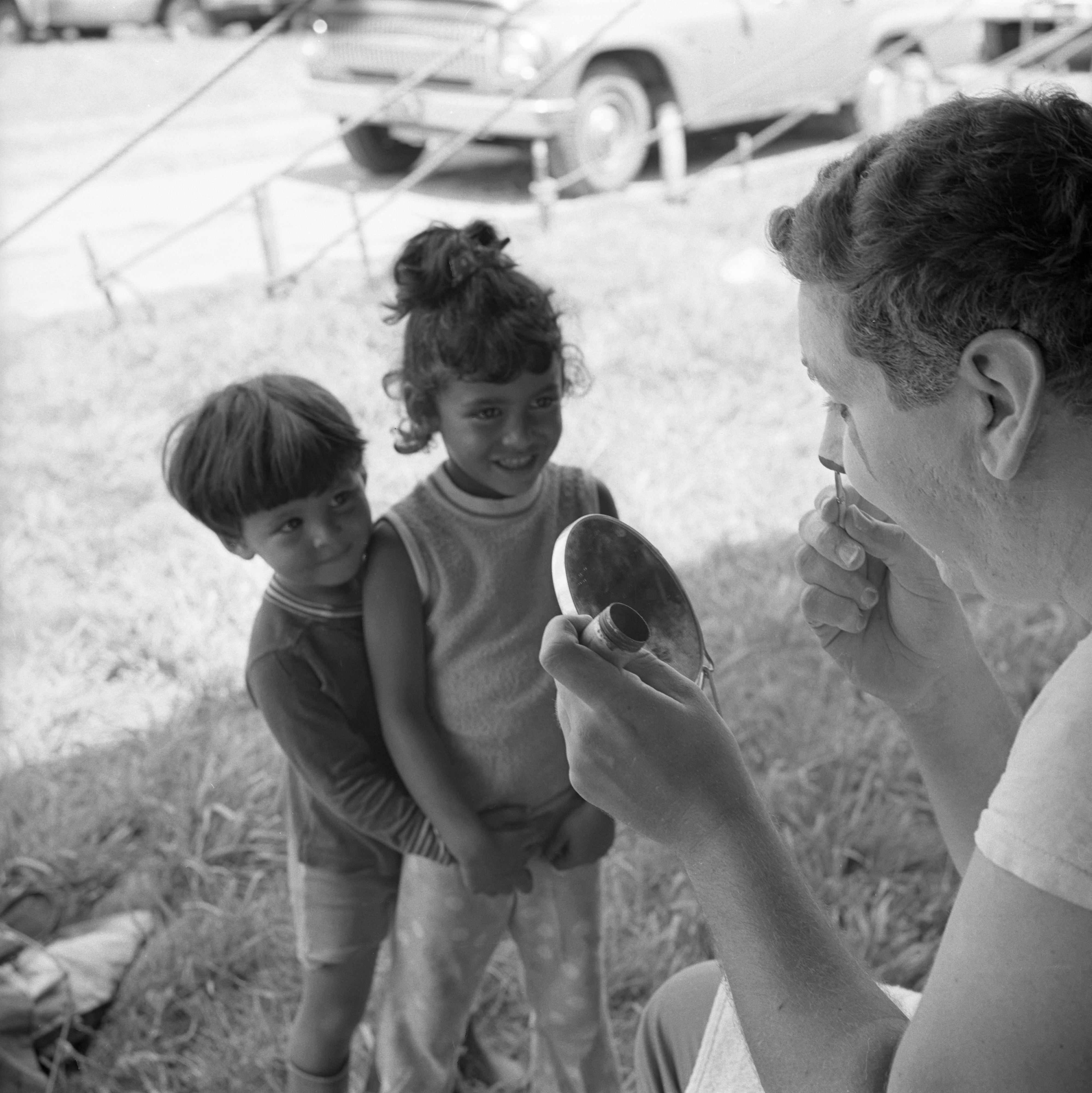 Kids Watch Clown Gets Ready For The Clyde-Beatty Cole Brothers Circus, August 8, 1968 image