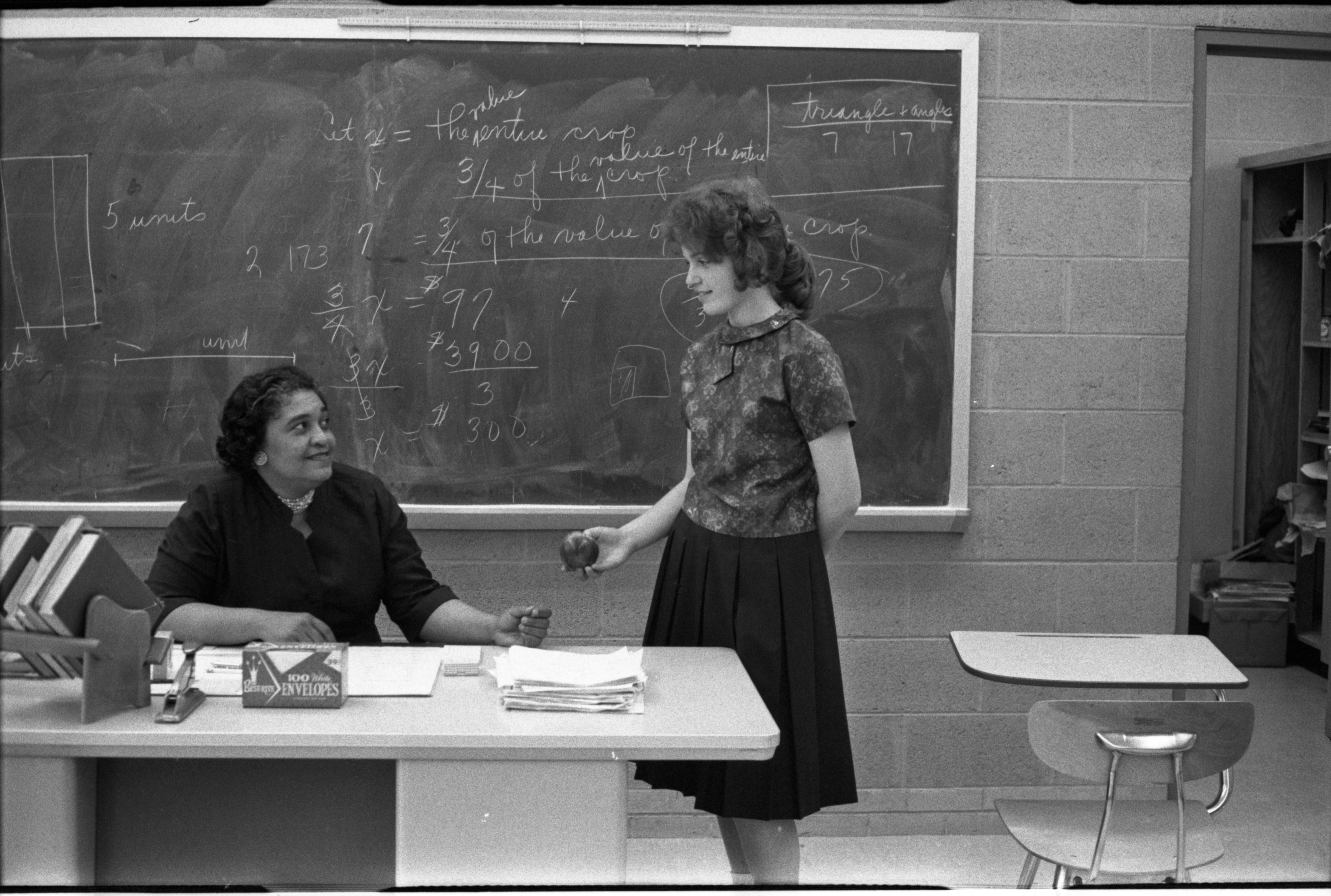 Teacher, Louise Bass, Gets An Apple From Student, Sharon Neustadt, May 1, 1962 image