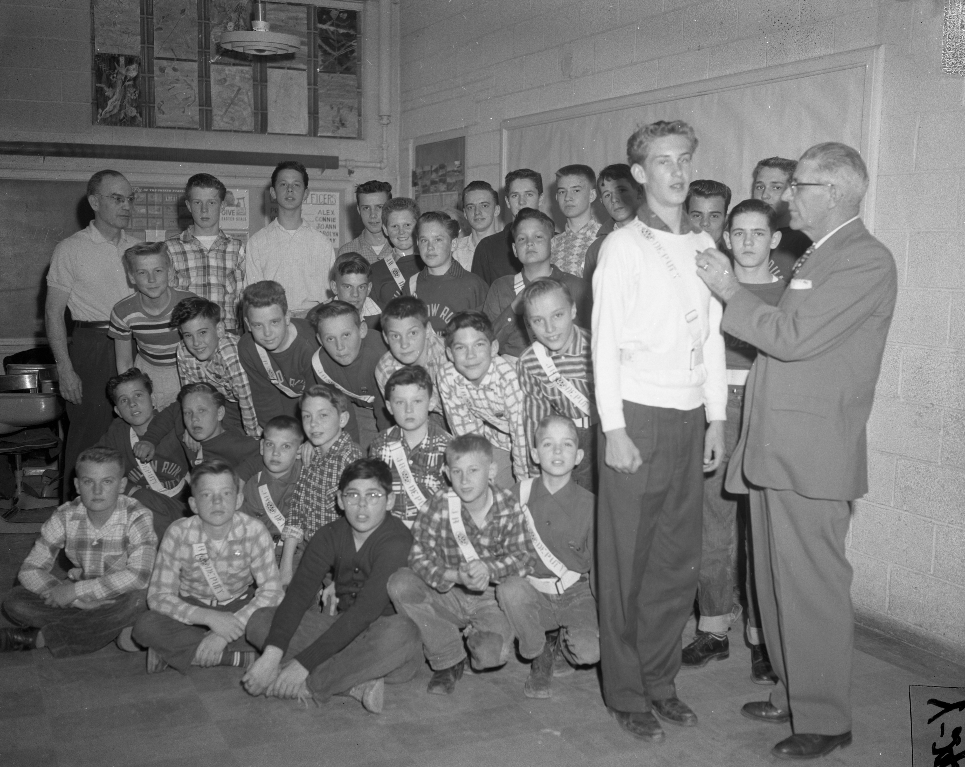 Washtenaw County's ninth chapter of the Junior Deputy League receives belts and badges, April 1957 image