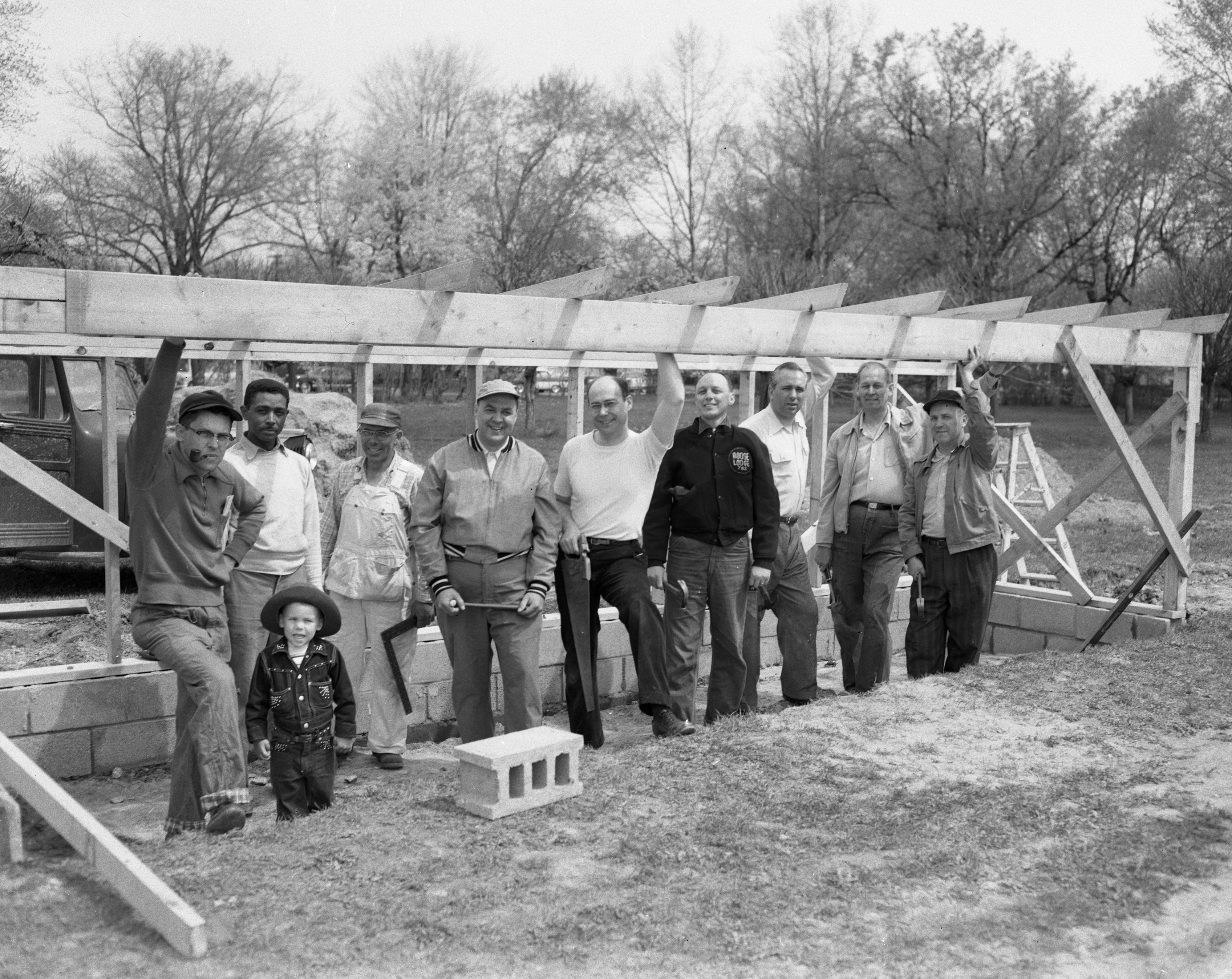 Fathers and managers of the American Little League construct dugouts at the baseball diamond, Recreation Park, Ypsilanti, April 1955 image
